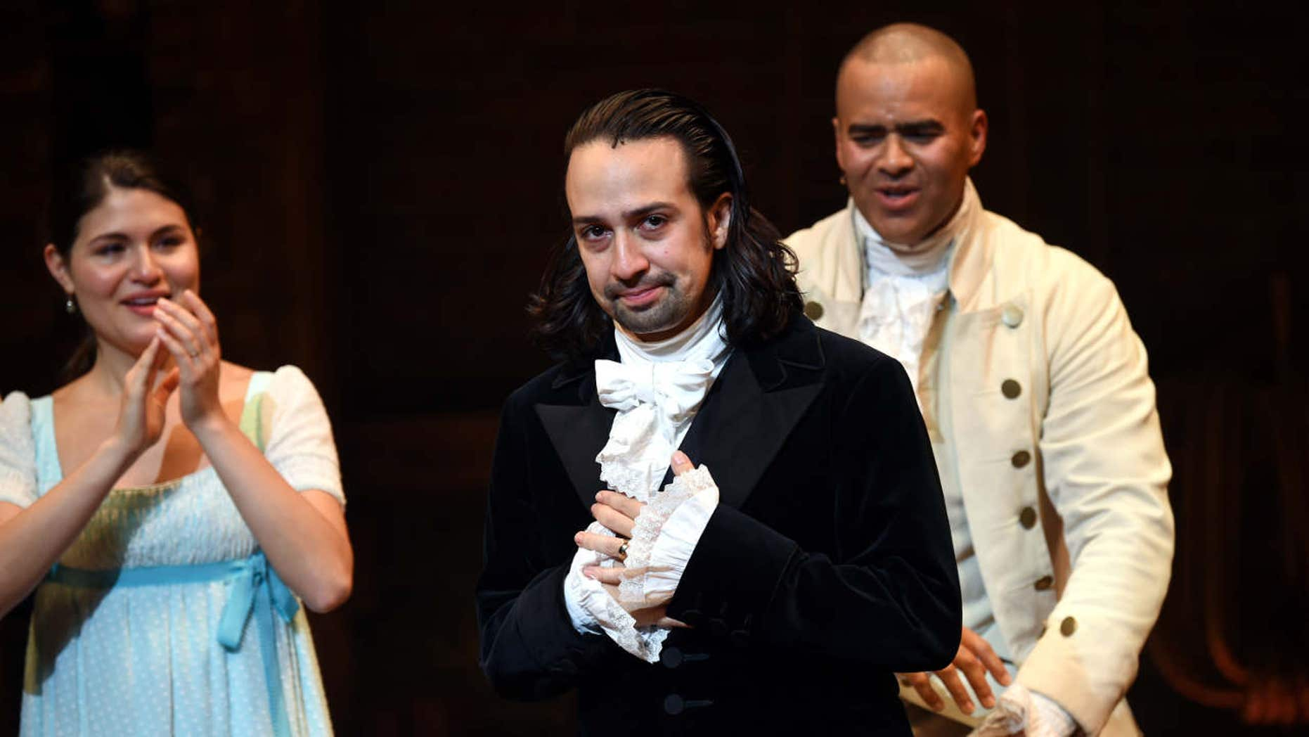 "Actor and ""Hamilton"" creator Lin-Manuel Miranda, center, takes his final performance curtain call at the Richard Rogers Theatre on Saturday, July 9, 2016, in New York."