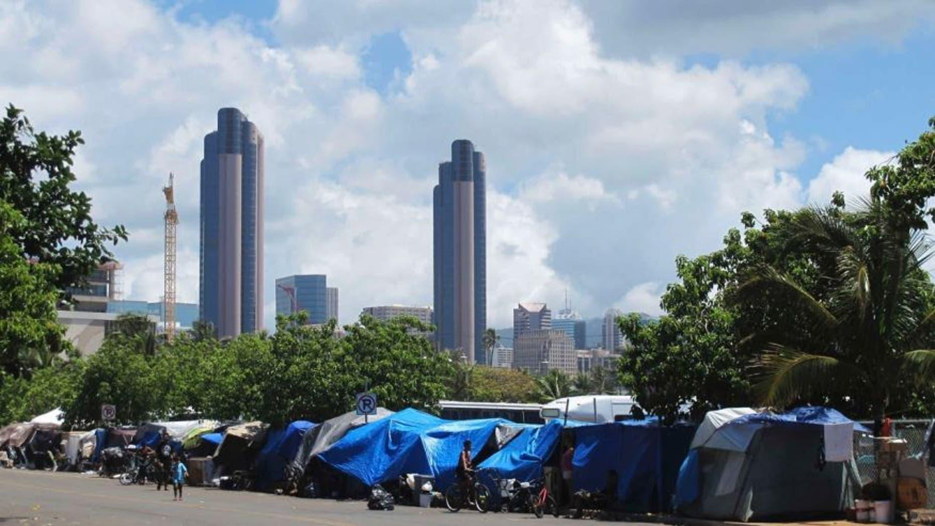 June 30, 2015: People camp out on a sidewalk in the Kakaako neighborhood of Honolulu, Hawaii.