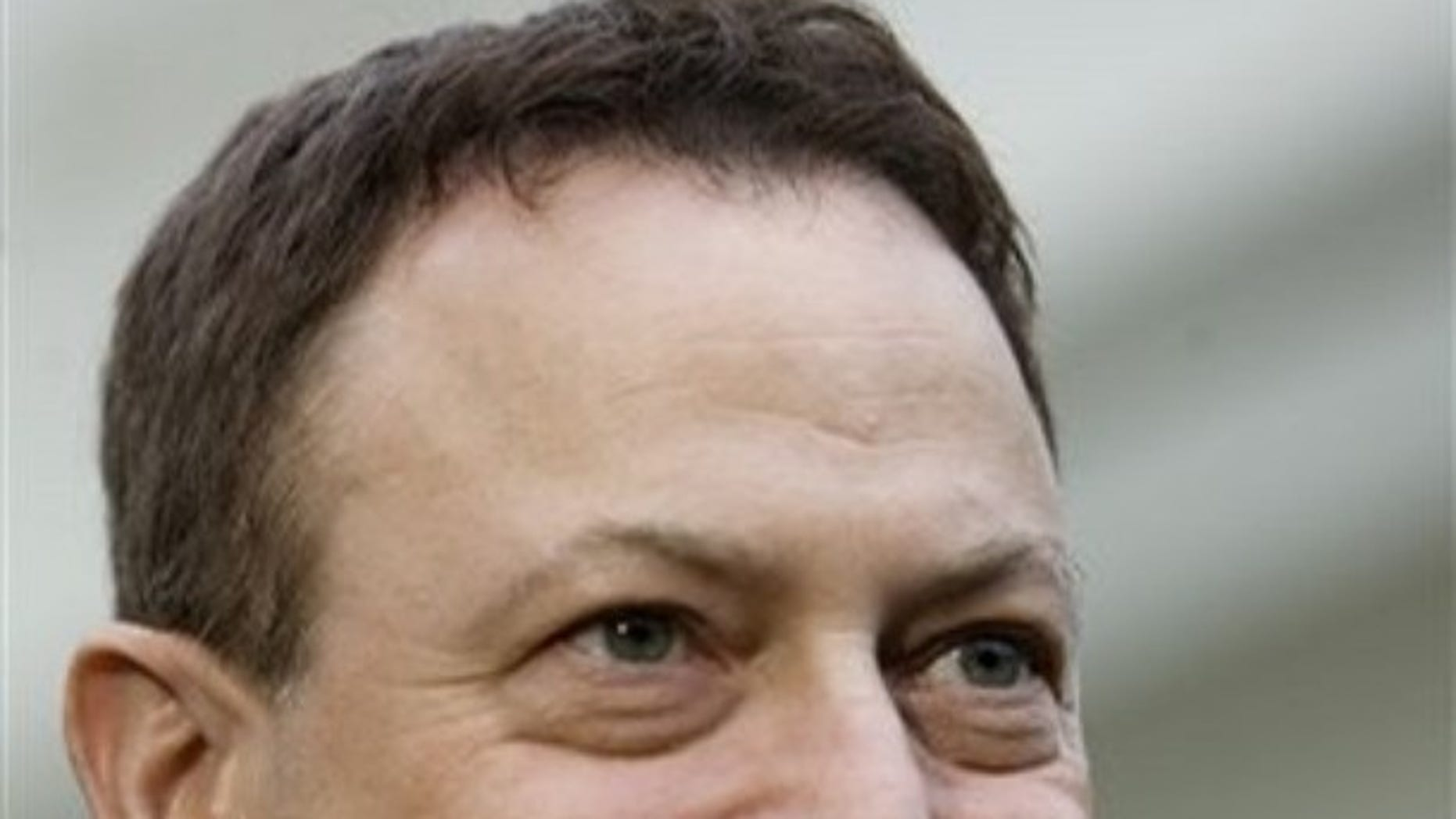 Actor Gary Sinise, a recipient of the 2008 Presidential Citizens Medal, speaks with members of the press, Wednesday, Dec. 10, 2008, outside the White House in Washington. (AP Photo/Haraz N. Ghanbari)