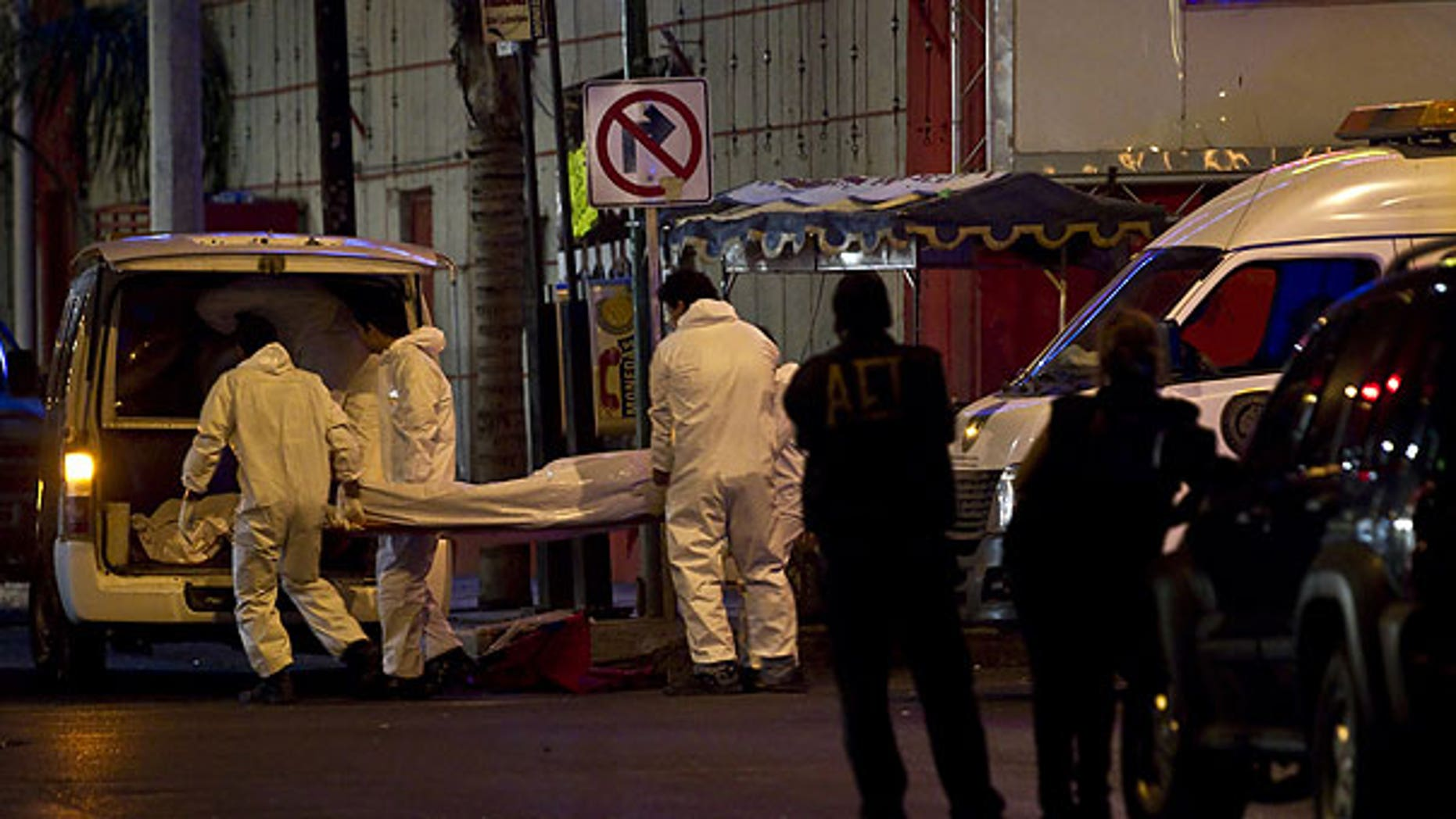 July 8: Forensic workers load a truck with bodies after gunmen stormed into a nightclub in Monterrey, Mexic. At least 17 people were killed in the bar massacre Friday night in the northern Mexican city when riflemen opened fire on the clientele and employees, a state forensic investigator said.