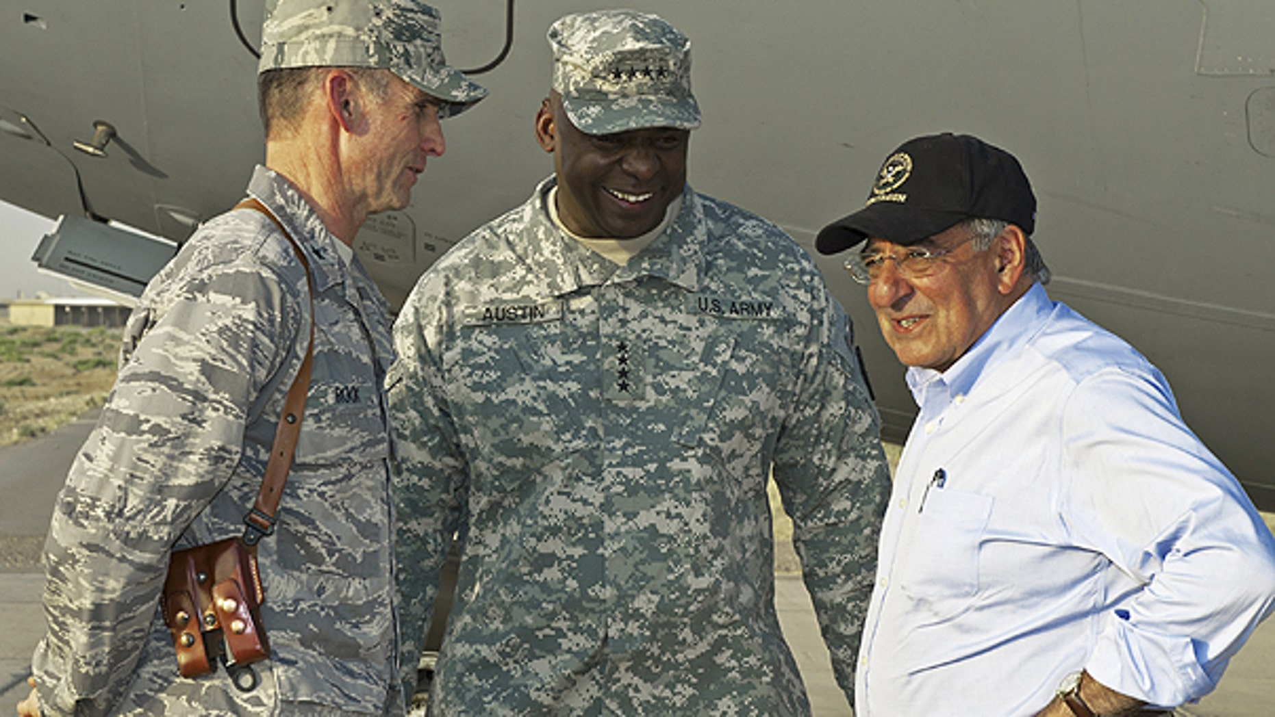 July 10: U.S. Secretary of Defense Leon Panetta, right, has a brief chat with his U.S. Generals Anthony Rock, left, and Lloyd Austin during an unannounced visit by the U.S. Secretary to Camp Dwyer in southern Afghanistan.