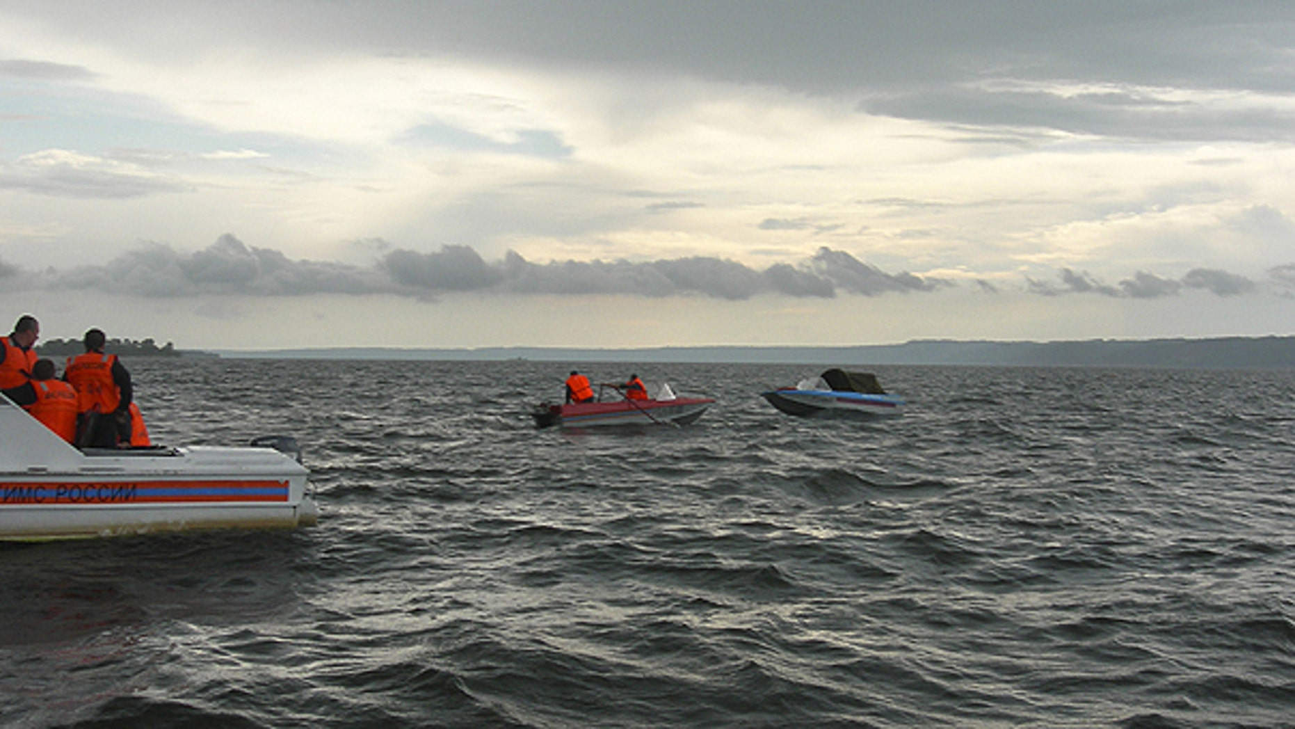 July 10: In this photo provided by Russia Emergency Situations Ministry press service, shows rescue boats trying to locate passengers of a tourist boat that sunk on the Volga River, in central Russia.