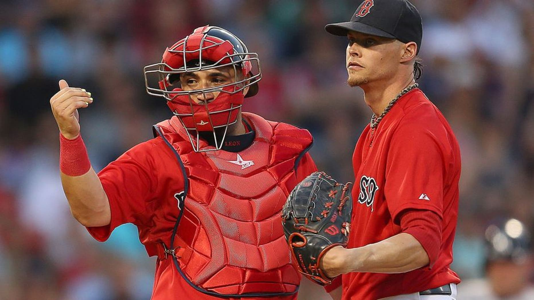 BOSTON, MA - JULY 10: Sandy Leon #3 of the Boston Red Sox signals to the dugout as Clay Buchholz #11 reacts on the mound in the fourth inning New York Yankees at Fenway Park on July 10, 2015 in Boston, Massachusetts. Buchholz left the game moments later. (Photo by Jim Rogash/Getty Images)