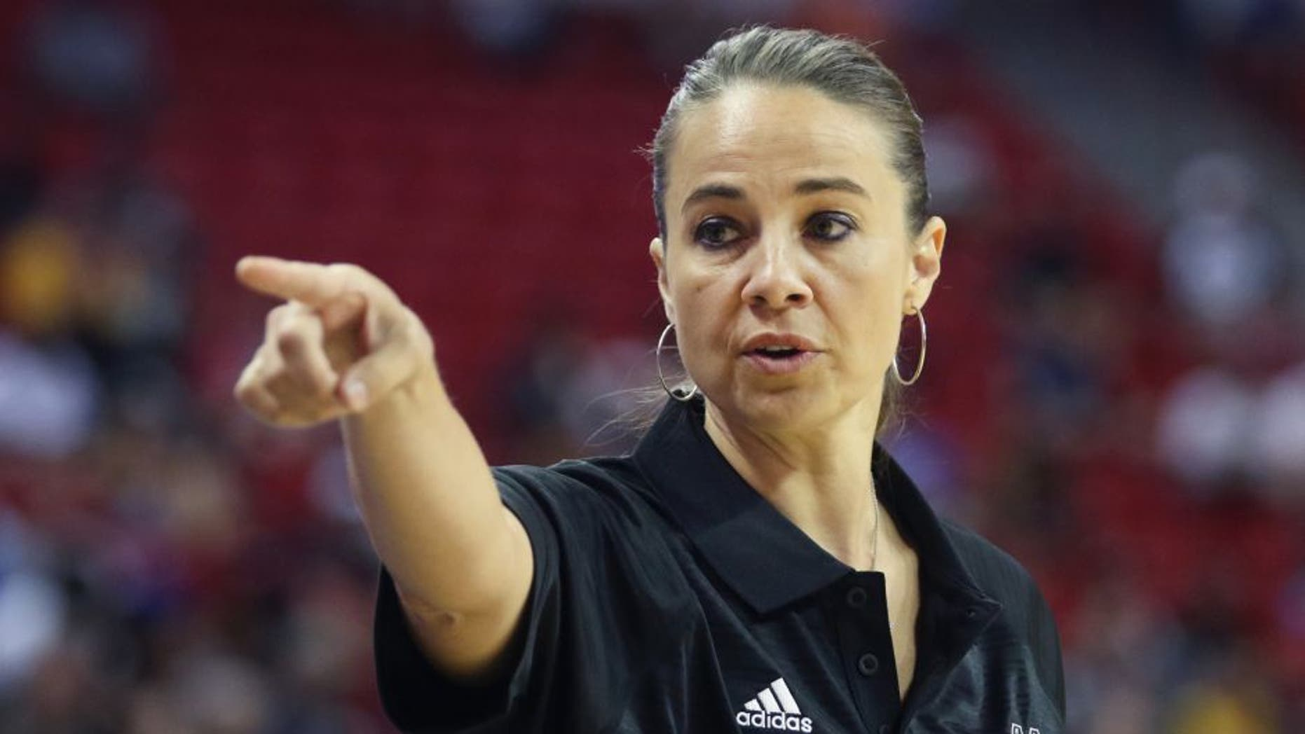 Becky Hammon coaches the San Antonio Spurs during an NBA summer league basketball game against the New York Knicks on Saturday, July 11, 2015, in Las Vegas. (AP Photo/Ronda Churchill)