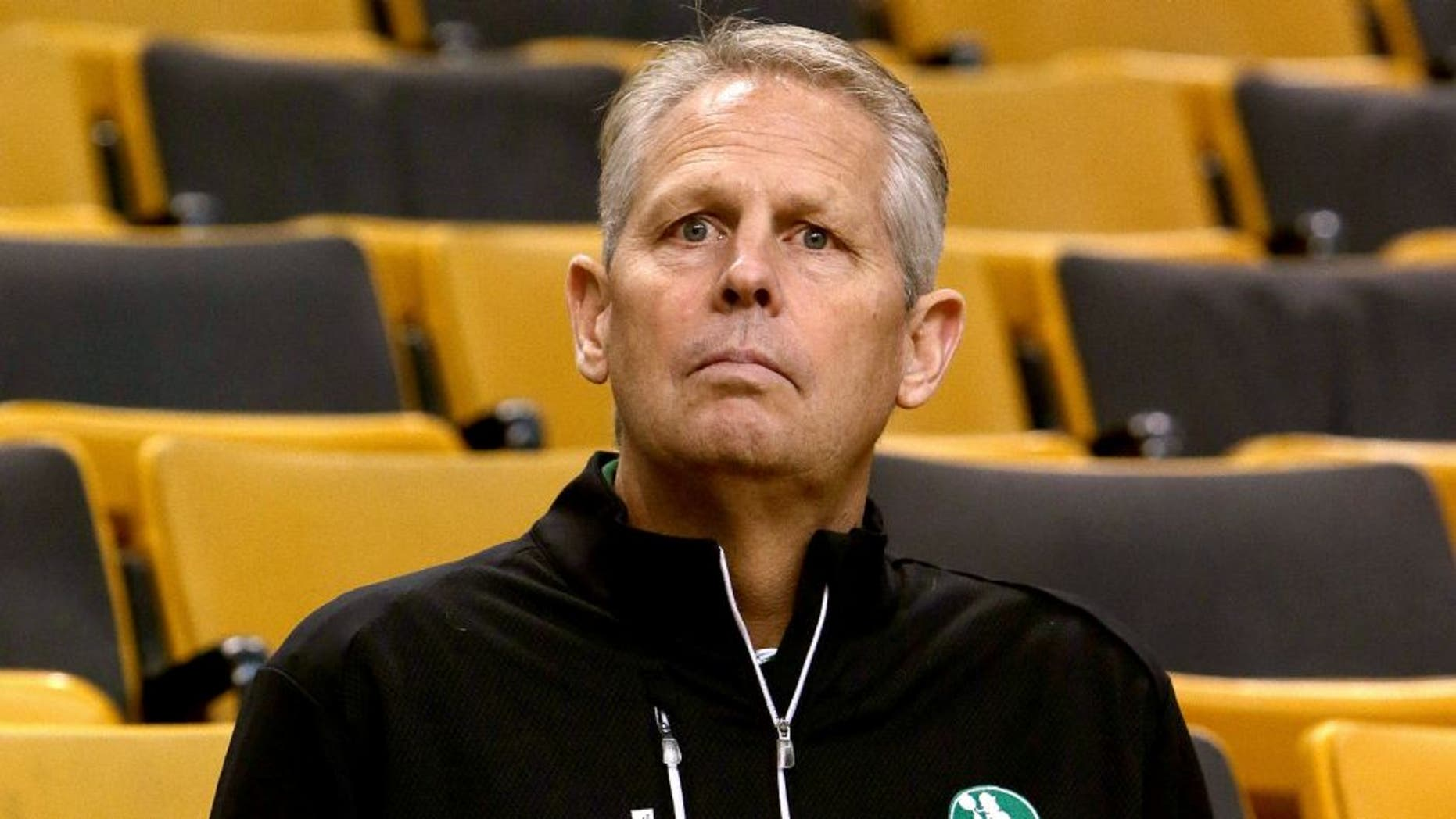 BOSTON - OCTOBER 22: Boston Celtics President of Basketball Operations Danny Ainge in Red Auerbach's old seat. The Boston Celtics take on the Brooklyn Nets in a preseason exhibition game at TD Garden. (Photo by Barry Chin/The Boston Globe via Getty Images)