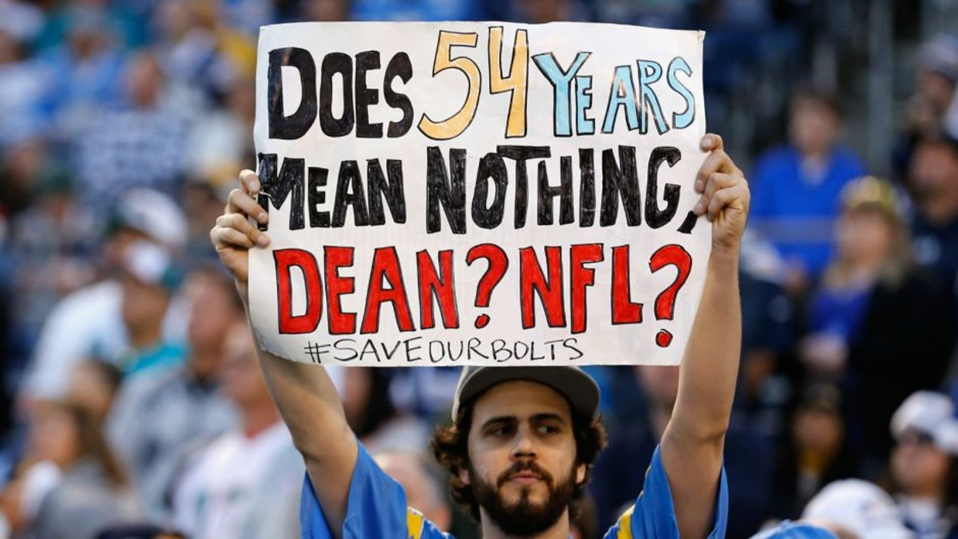 at Qualcomm Stadium on December 20, 2015 in San Diego, California.,SAN DIEGO, CA - DECEMBER 20: A fan holds a sign supporting the San Diego Chargers during a game against the Miami Dolphins at Qualcomm Stadium on December 20, 2015 in San Diego, California. (Photo by Sean M. Haffey/Getty Images)