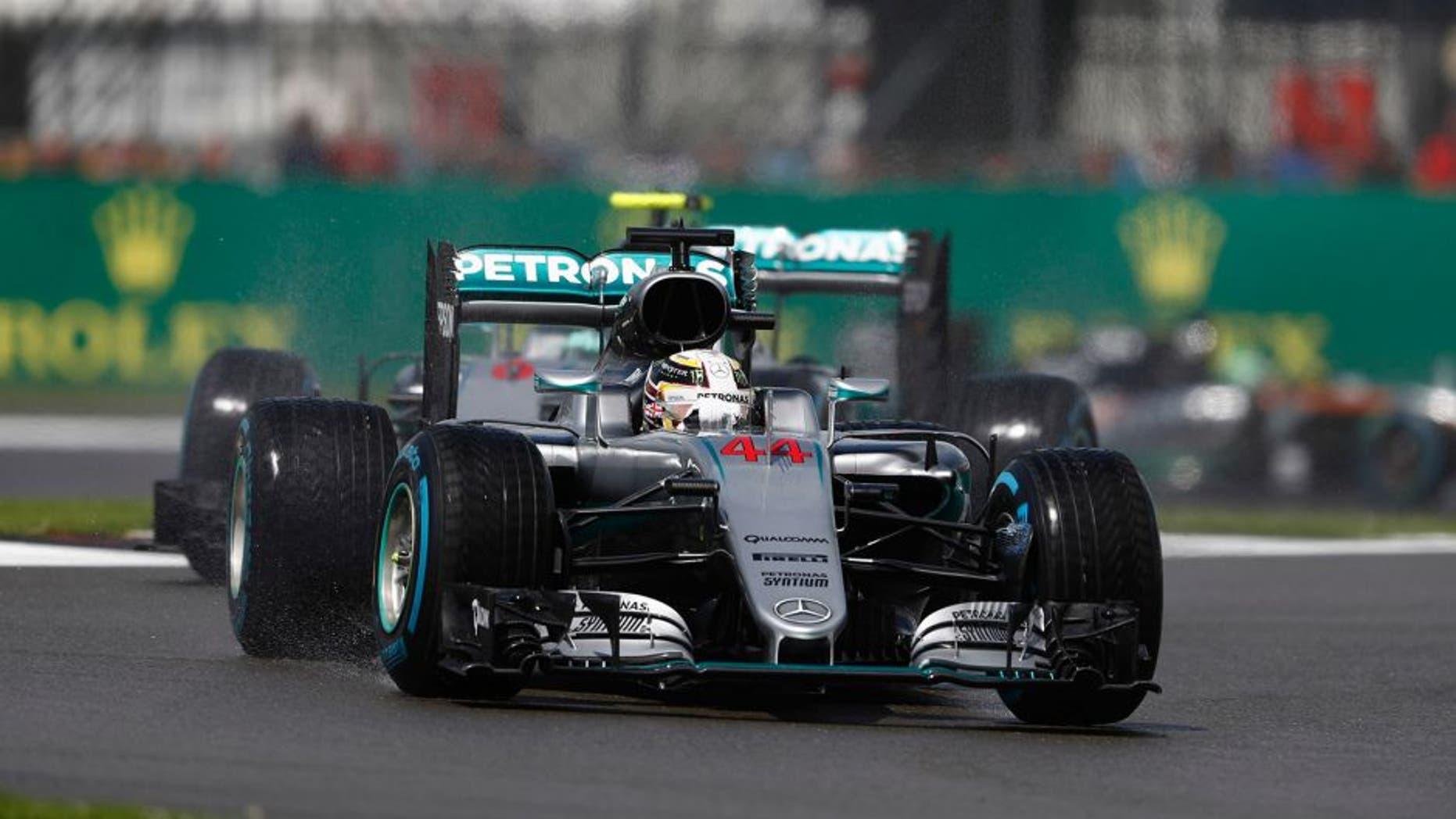 Silverstone, Northamptonshire, UK Sunday 10 July 2016. Lewis Hamilton, Mercedes F1 W07 Hybrid, leads Nico Rosberg, Mercedes F1 W07 Hybrid. World Copyright: Glenn Dunbar/LAT Photographic ref: Digital Image _V2I0159
