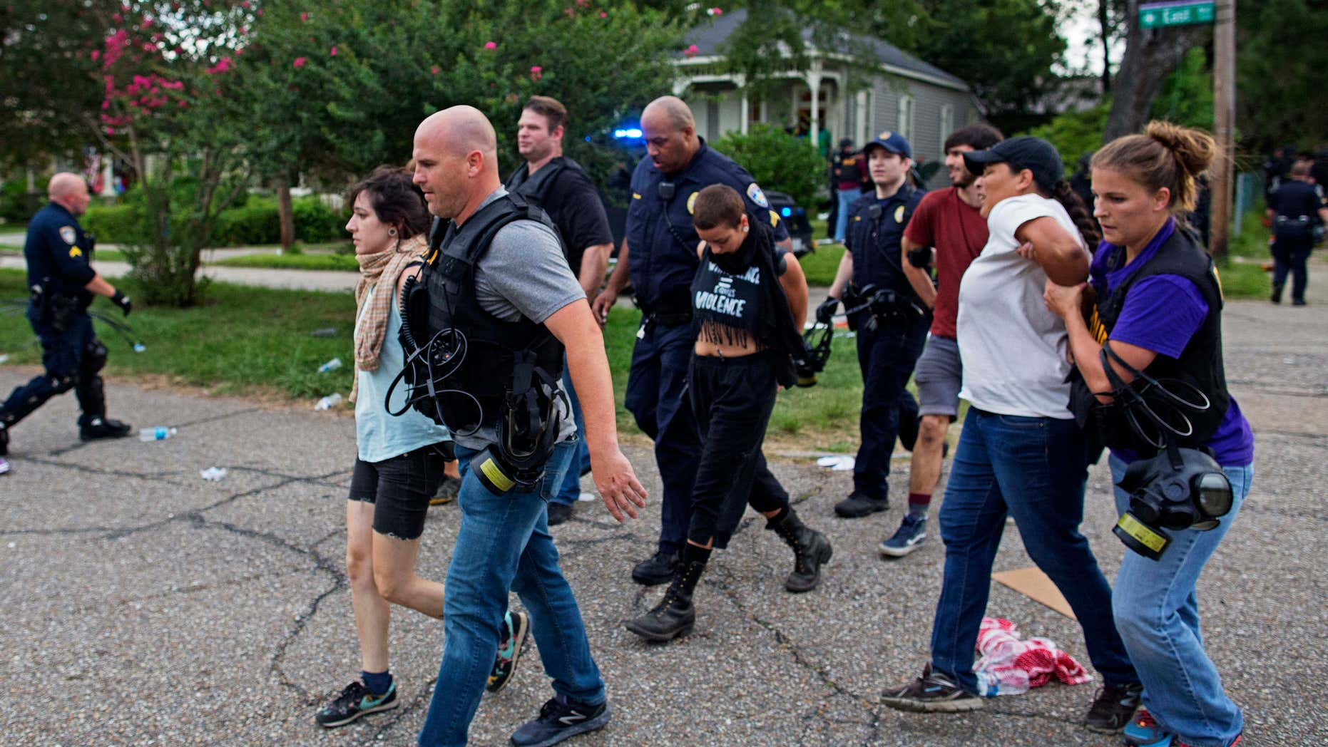 July 10, 2016: Police arrest protesters in a residential neighborhood in Baton Rouge, La.