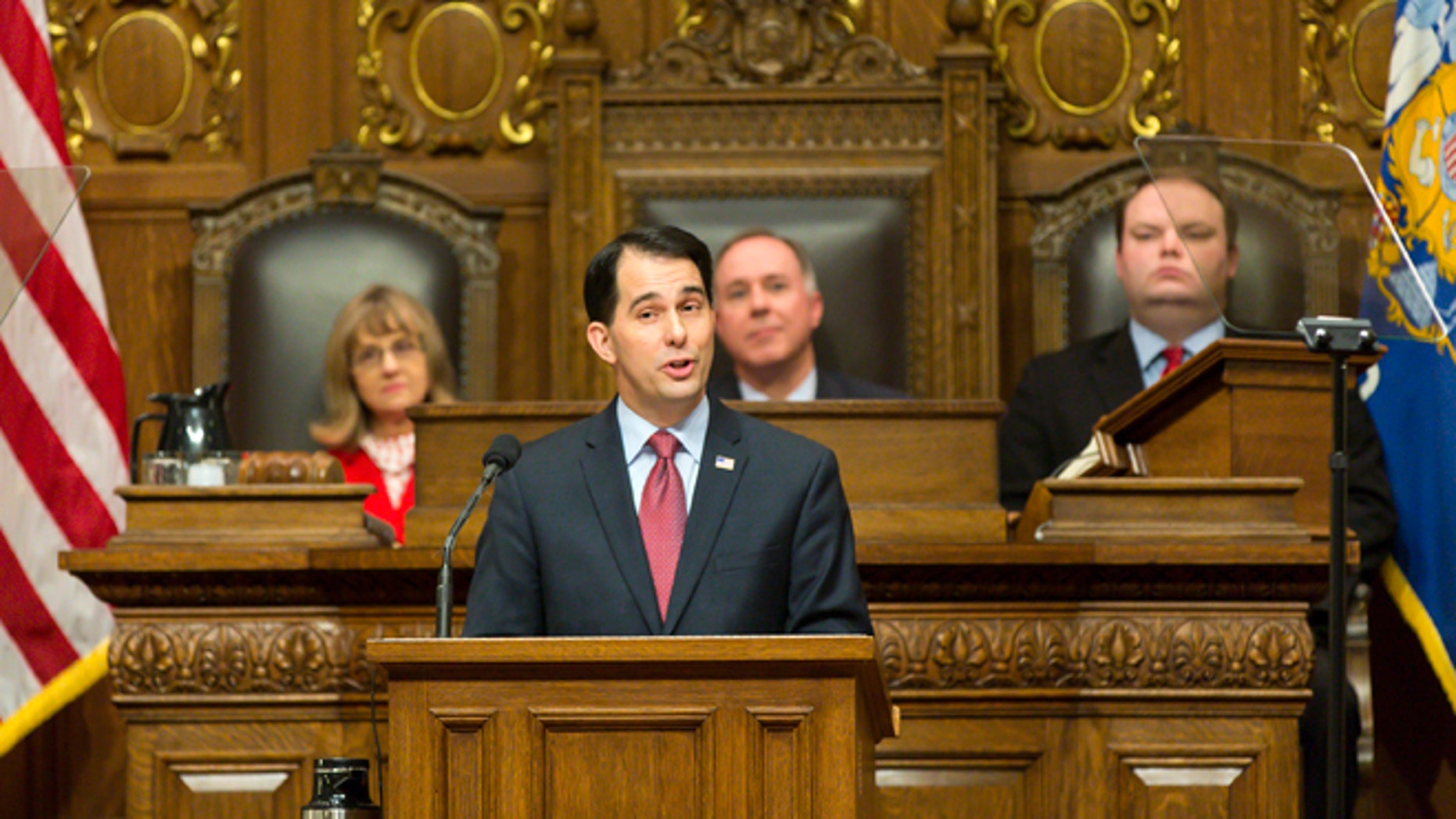 Jan. 13, 2015: Wisconsin Gov. Scott Walker, center, addresses a joint session of the state Legislature during the Governor's State of the State speech in the Assembly chambers at the state Capitol in Madison, Wis.