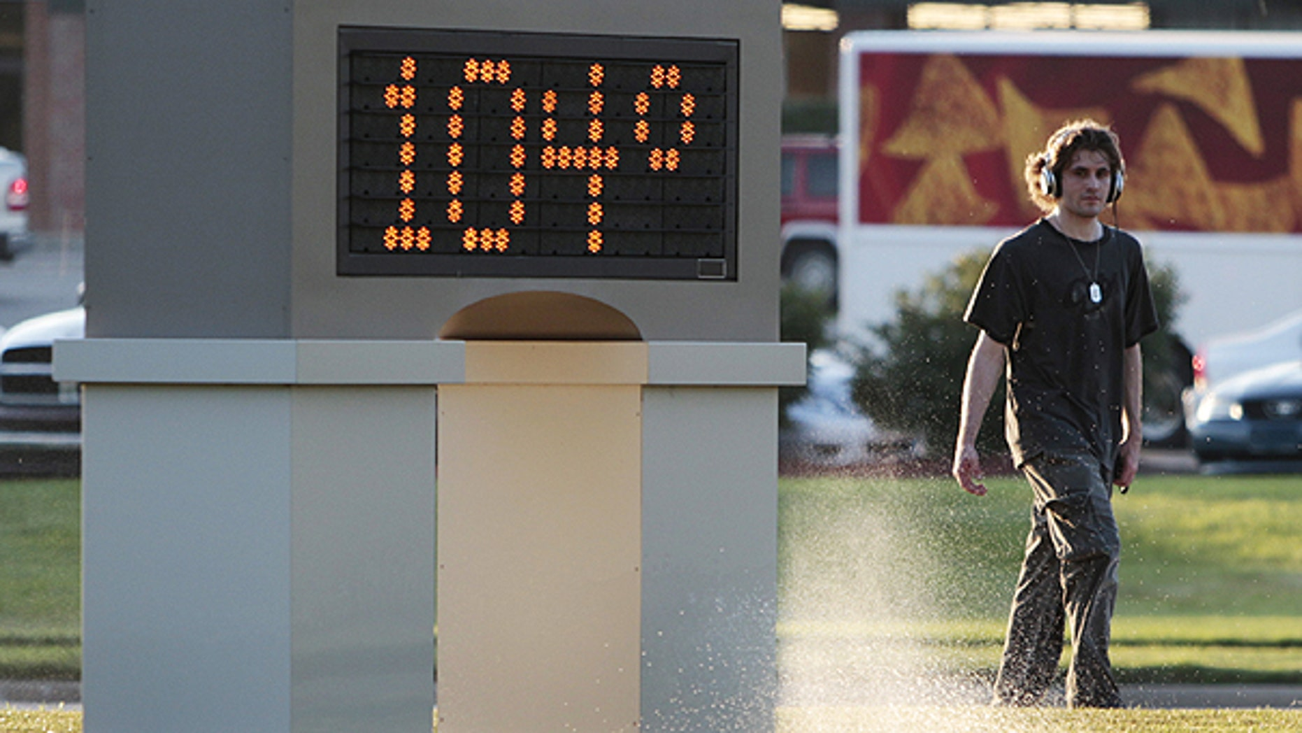 July 11: An unidentified pedestrian walks past a time and temperature sign in Lawrence, Kan.