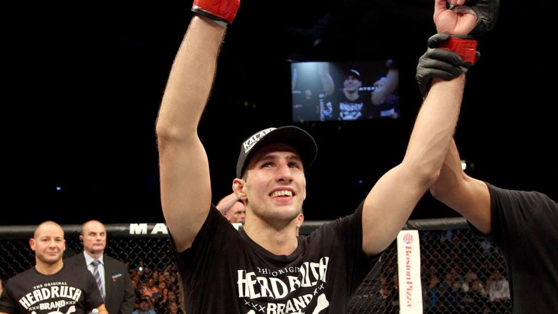 HALIFAX, NS - OCTOBER 4: Rory MacDonald of Canada celebrates after defeating Tarec Saffiedine of Belgium in their welterweight bout at the Scotiabank Centre on October 4, 2014 in Halifax, Nova Scotia, Canada. (Photo by Nick Laham/Zuffa LLC/Zuffa LLC via Getty Images)