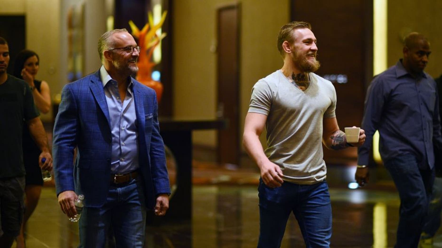 LAS VEGAS, NV - MARCH 23: UFC featherweight title challenger Conor McGregor of Ireland (R) walks with UFC CEO Lorenzo Fertitta during the UFC 189 World Championship Press Tour stop at the Red Rock Casino Resort on March 23, 2015 in Las Vegas, Nevada. (Photo by Jeff Bottari/Zuffa LLC/Zuffa LLC via Getty Images)