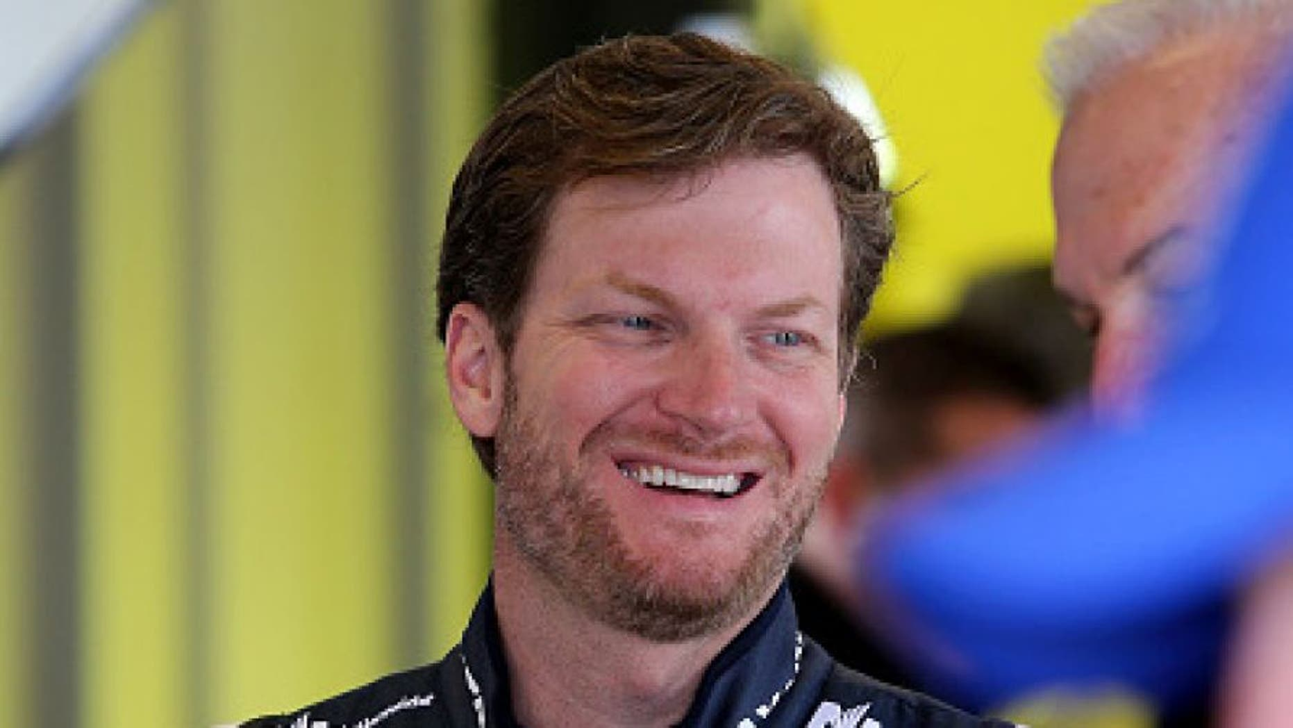SPARTA, KY - JULY 07: Dale Earnhardt Jr., driver of the #88 Nationwide Chevrolet, stands in the garage area during practice for the NASCAR Sprint Cup Series Quaker State 400 at Kentucky Speedway on July 7, 2016 in Sparta, Kentucky. (Photo by Jerry Markland/Getty Images)