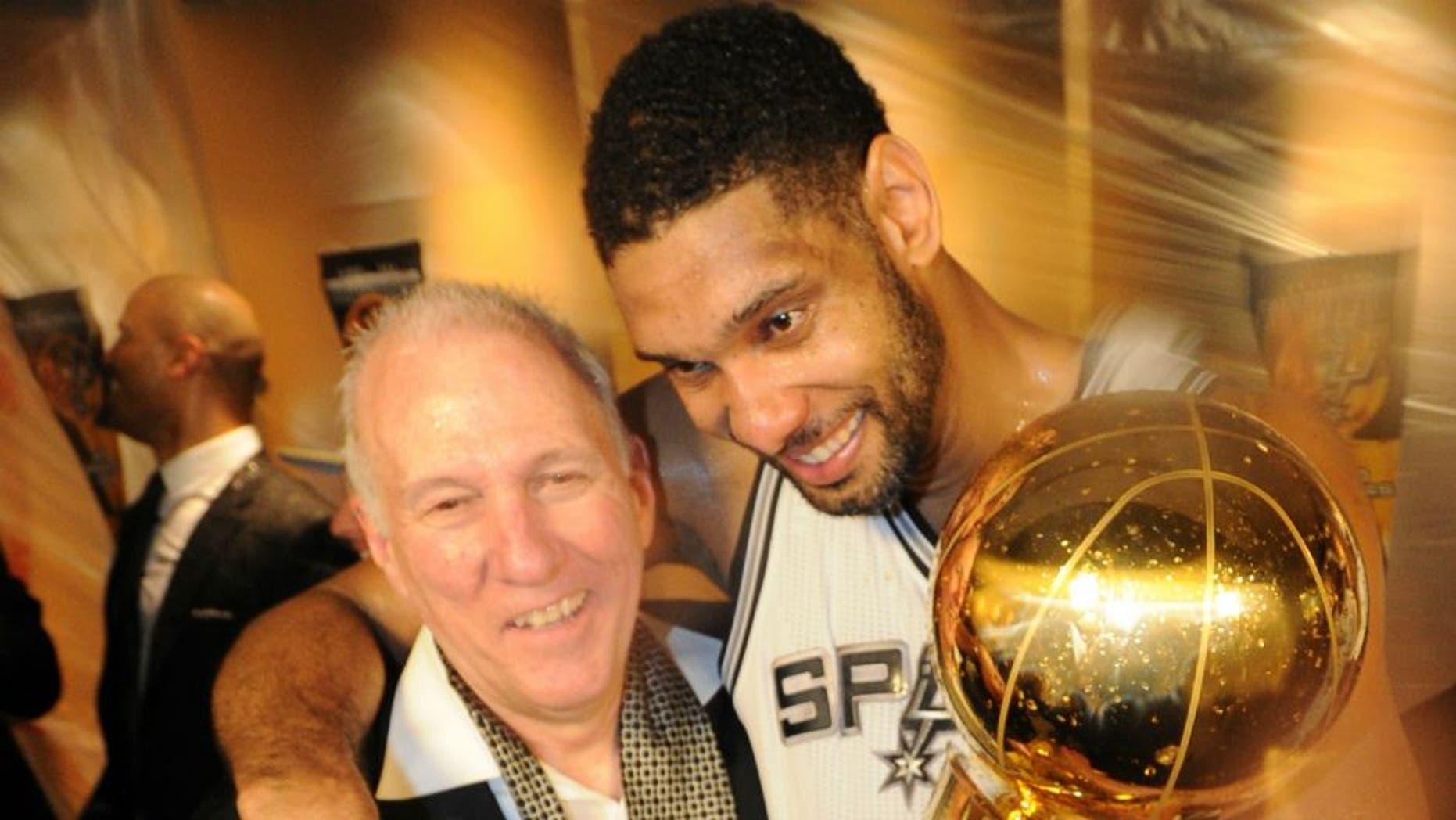 SAN ANTONIO, TX - JUNE 15: Tim Duncan #21 and Head Coach Gregg Popovich of the San Antonio Spurs celebrates after winning the NBA Championship against the Miami Heat during Game Five of the 2014 NBA Finals between the Miami Heat and San Antonio Spurs at AT&T Center on June 15, 2014 in San Antonio, Texas. NOTE TO USER: User expressly acknowledges and agrees that, by downloading and/or using this photograph, user is consenting to the terms and conditions of the Getty Images License Agreement. Mandatory Copyright Notice: Copyright 2014 NBAE (Photo by Andrew D Bernstein/NBAE via Getty Images)
