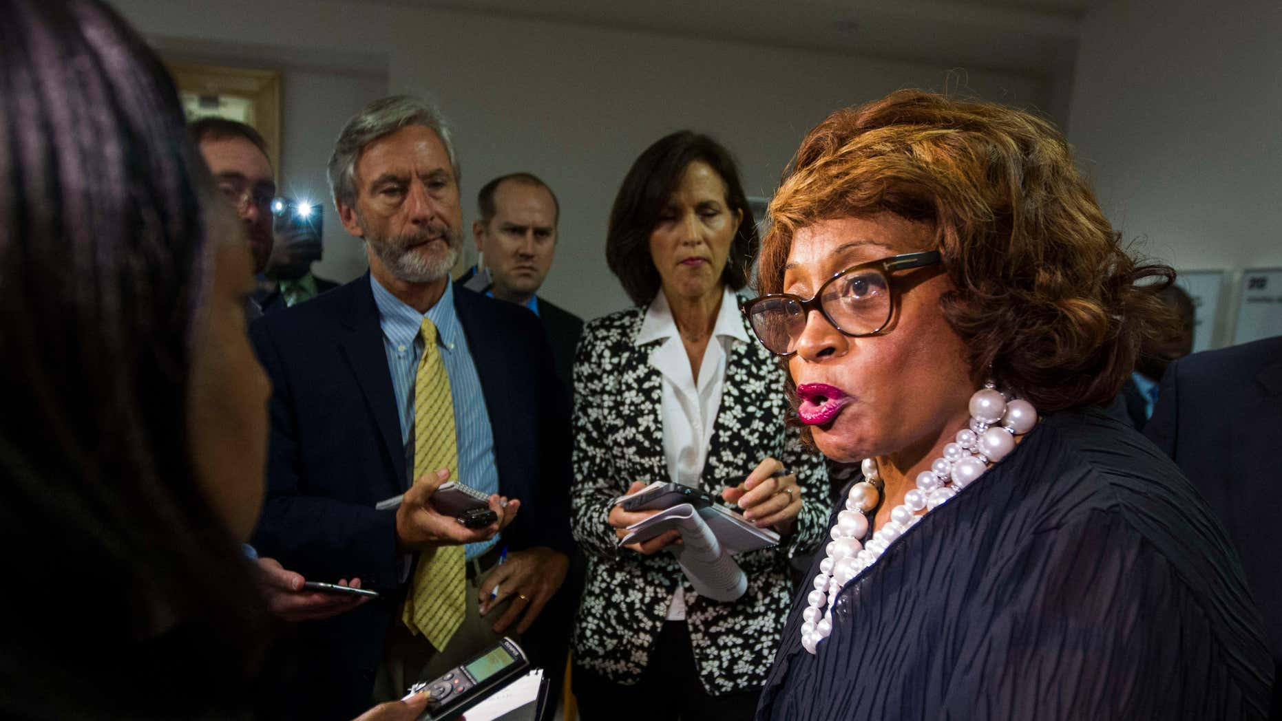 FILE - In this Aug. 13, 2015 file photo, Rep. Corrine Brown, D-Fla. talks with the press in Tallahassee, Fla.