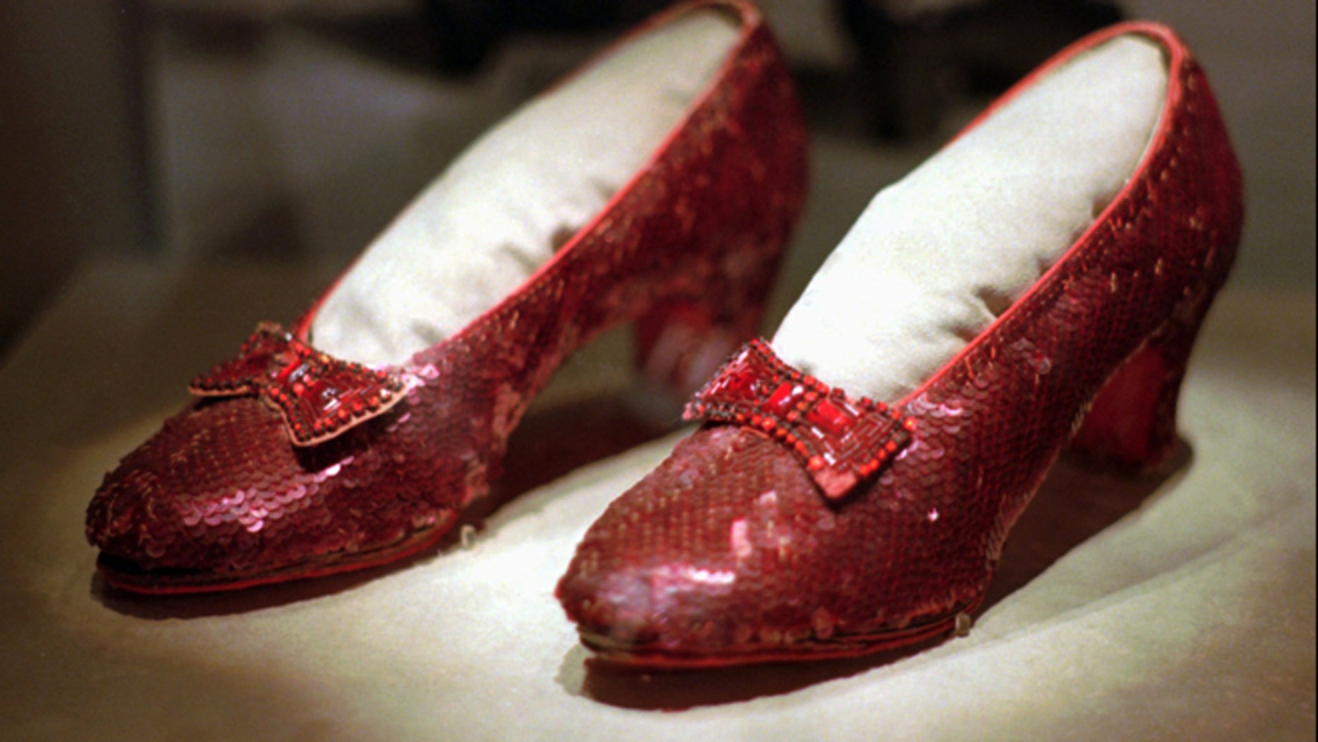 """April 10, 1996: This file photo shows one of the four pairs of ruby slippers worn by Judy Garland in the 1939 film """"The Wizard of Oz"""" on display during a media tour of the """"America's Smithsonian"""" traveling exhibition in Kansas City, Mo."""