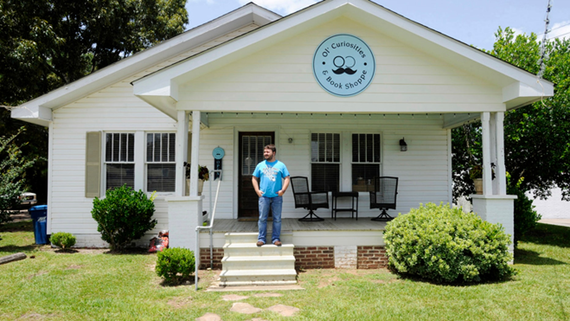 July 8, 2015: Spencer Madrie poses outside his store, Ol' Curiosities & Book Shoppe, in Monroeville, Ala.