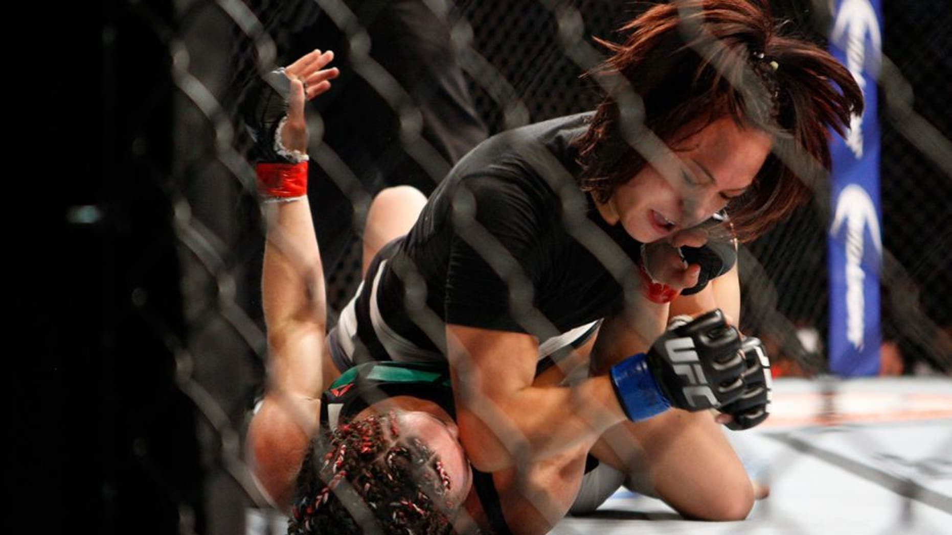 LAS VEGAS, NV - JULY 12: Michelle Waterson (top) elbows Angela Magana in their women's strawweight bout during the Ultimate Fighter Finale inside MGM Grand Garden Arena on July 12, 2015 in Las Vegas, Nevada. (Photo by Mitch Viquez/Zuffa LLC/Zuffa LLC via Getty Images)