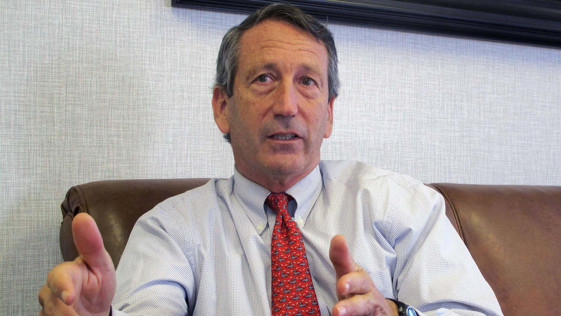 FILE - In this Dec. 18, 2013, file photo, U.S. Rep. Mark Sanford, R-S.C., discusses his first months back in Congress during an interview in Mount Pleasant, S.C.