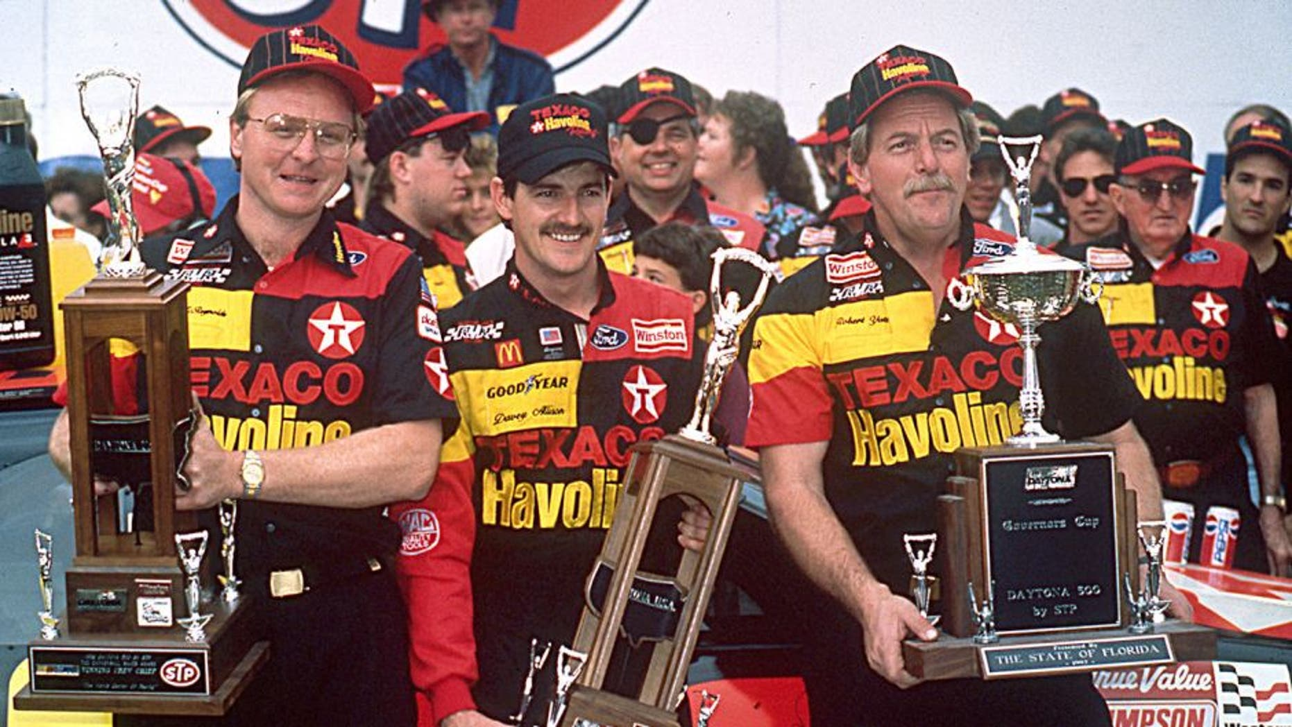 DAYTONA BEACH, FL ? February 16, 1992: Davey Allison (C) celebrates in victory lane at Daytona International Speedway with crew chief Larry McReynolds (L) and car owner Robert Yates (R) after winning the Daytona 500 NASCAR Cup race. (Photo by ISC Images & Archives via Getty Images)