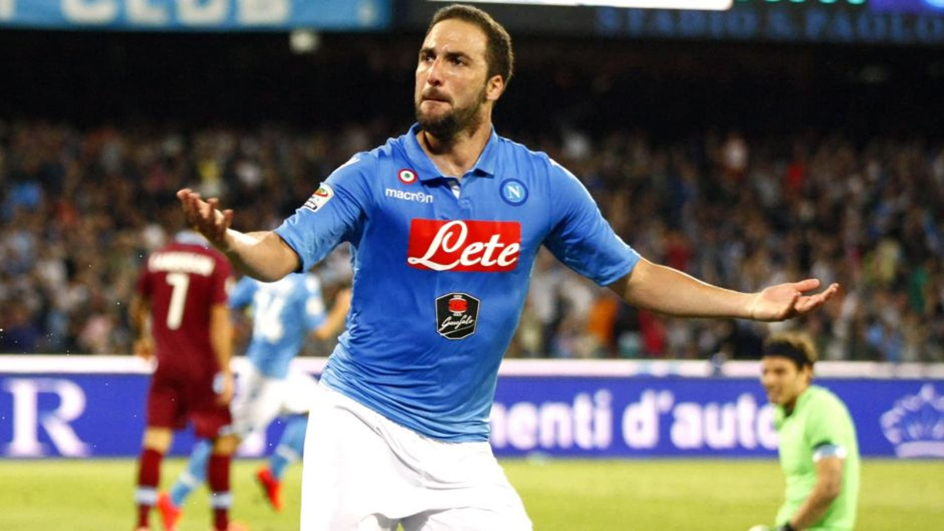 Napoli's forward from Argentina and France Gonzalo Higuain celebrates after scoring during the Italian Serie A football match SSC Napoli vs SS Lazio on May 31, 2015 at the San Paolo stadium in Naples. AFP PHOTO/CARLO HERMANN (Photo credit should read CARLO HERMANN/AFP/Getty Images)