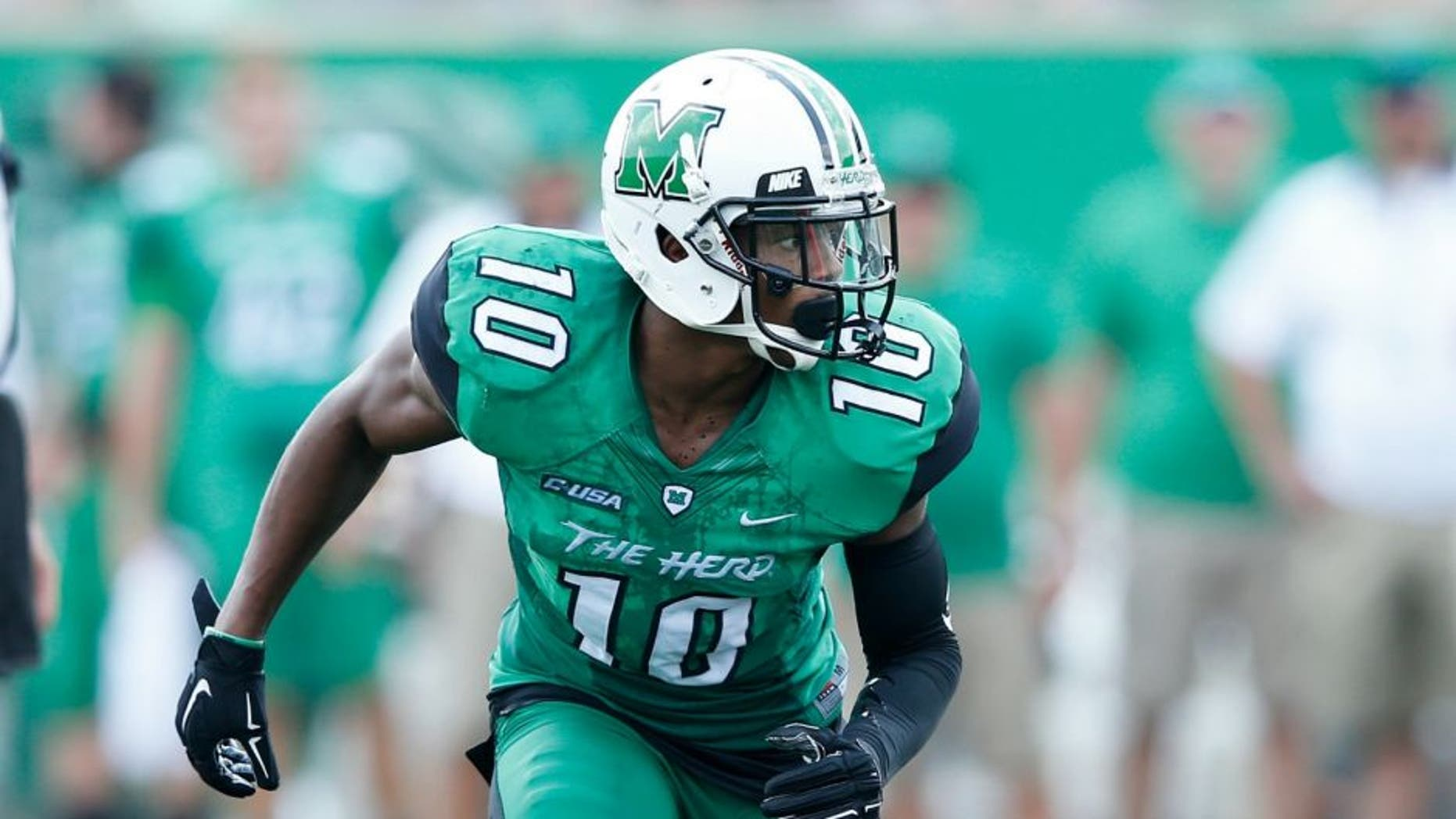 HUNTINGTON, WV - SEPTEMBER 6: Corey Tindal #10 of the Marshall Thundering Herd in action against the Purdue Boilermakers at Joan C. Edwards Stadium on September 6, 2015 in Huntington, West Virginia. Marshall defeated Purdue 41-31. (Photo by Joe Robbins/Getty Images)