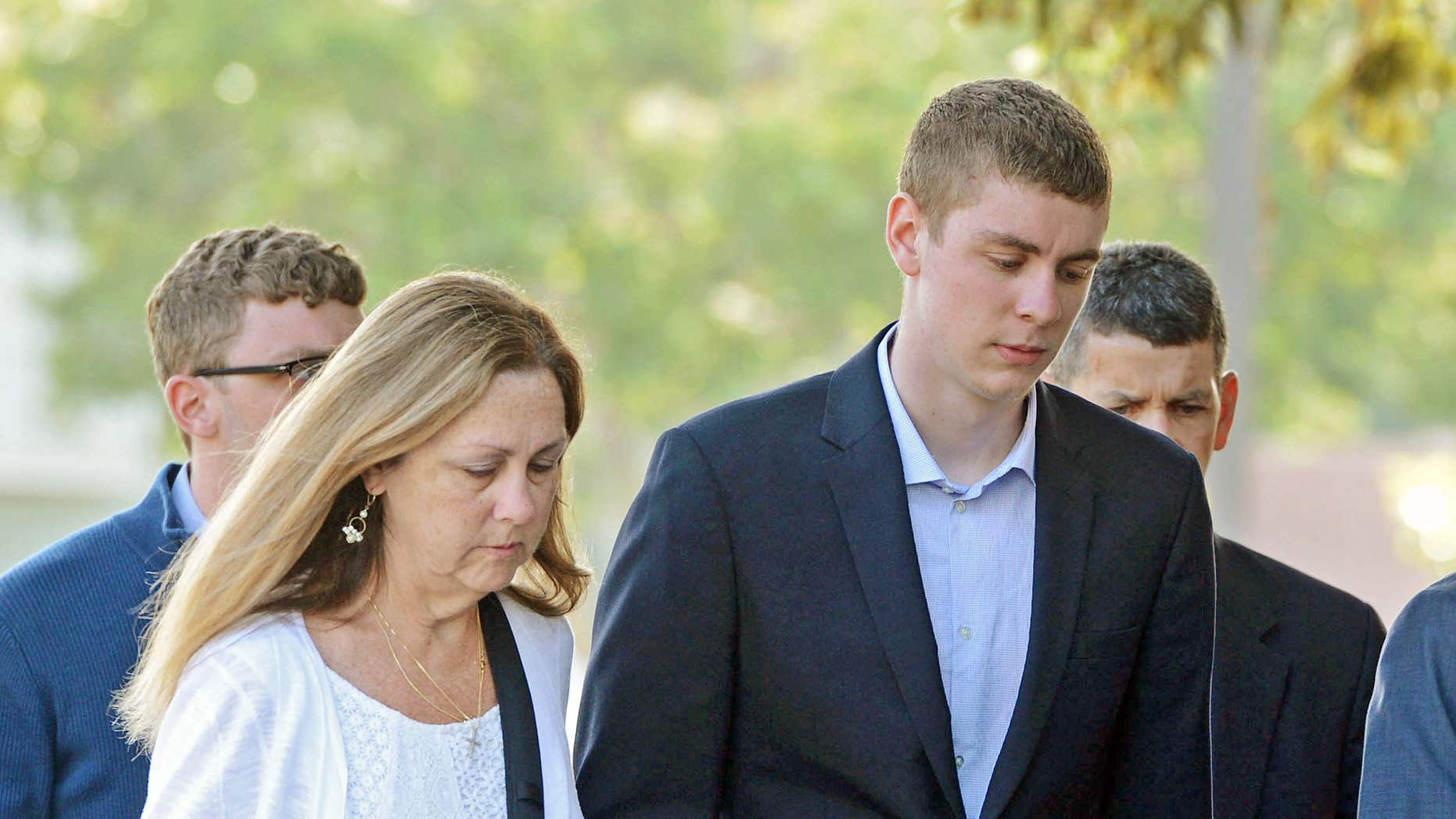 FILE - In this June 2, 2016 file photo, Brock Turner, 20, right, makes his way into the Santa Clara Superior Courthouse in Palo.