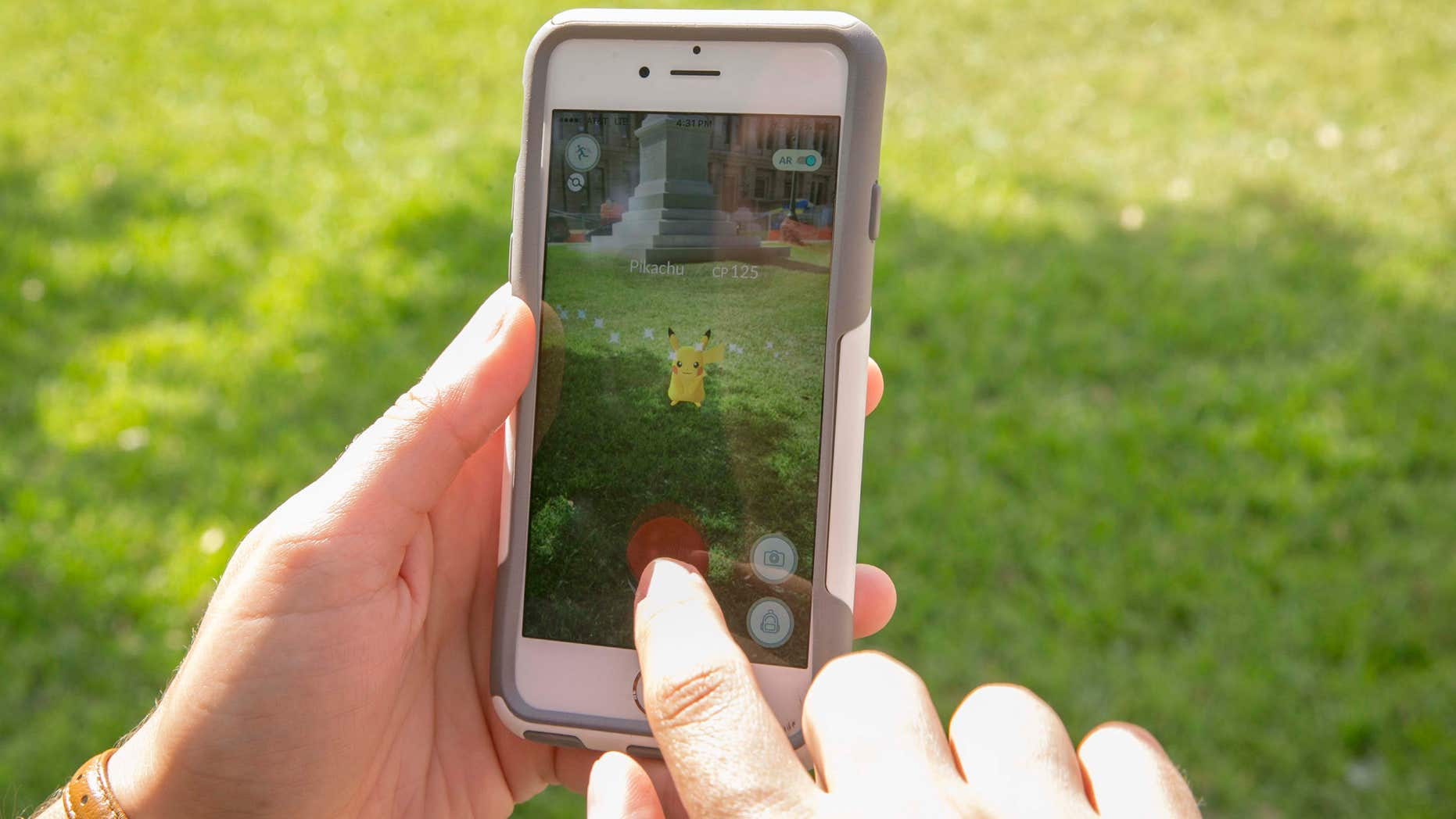 July 11, 2016: Sarah Boutwell plays the augmented-reality smartphone game Pokémon Go at the Capitol in Austin, Texas