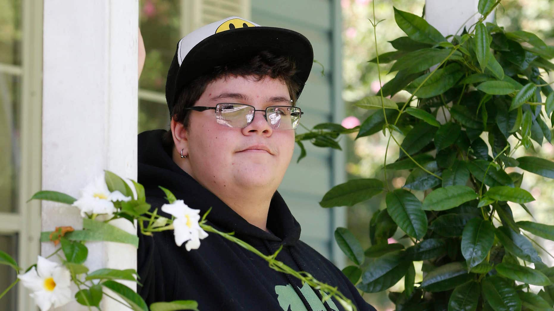 FILE - In this Aug. 25, 2015 file photo, Gavin Grimm poses on his front porch during an interview at his home in Gloucester, Va.