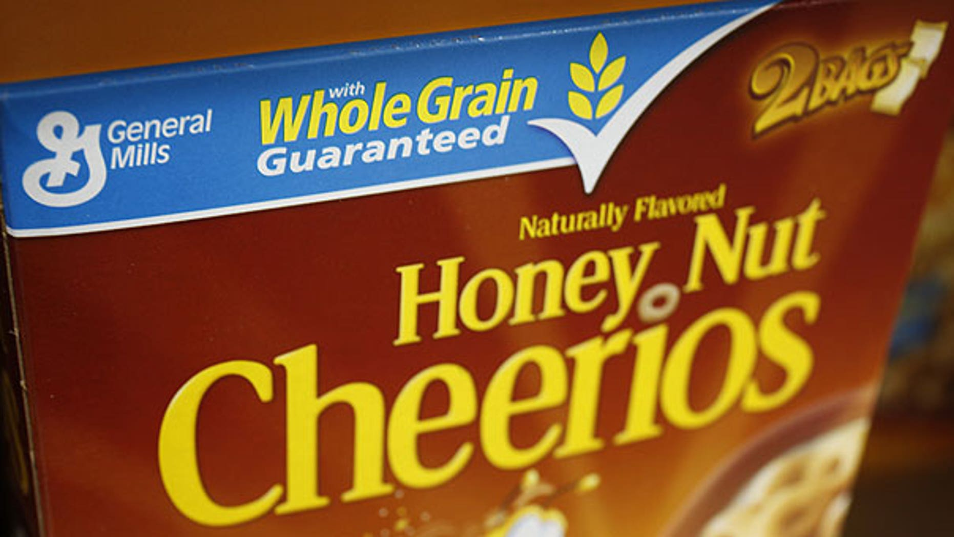 In this Dec. 8, 2009 photo, a box of Honey Nut Cheerios is seen on display at Costco in Mountain View, Calif. The nation's largest food companies say they will cut back on marketing unhealthier foods to children, proposing their own set of advertising standards after rejecting similar guidelines proposed by the federal government.
