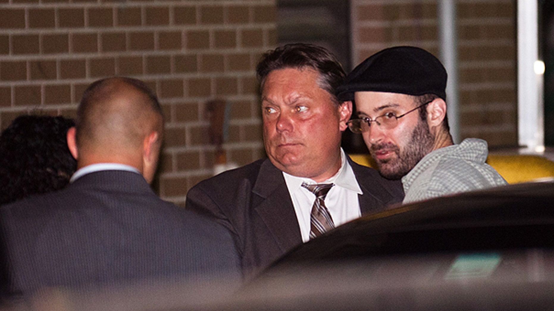 July 14: Levi Aron, right, the suspect accused killing and dismembering 8-year-old Brooklyn boy Leiby Kletzy, is led into the 67th Precinct by police in Brooklyn.