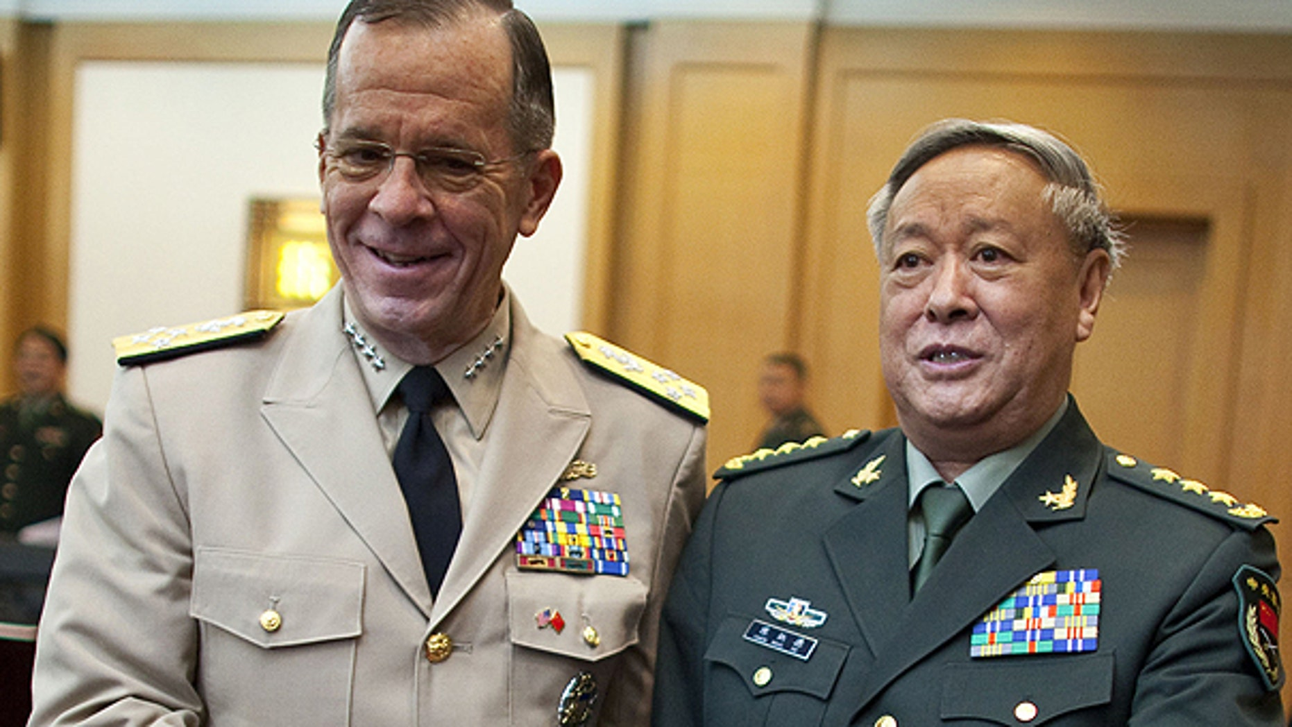 July 11: U.S. Adm. Mike Mullen, left, chairman of the Joint Chiefs of Staff, shakes hands with Gen. Chen Bingde, chief of the General Staff of the Chinese People's Liberation Army, before their meeting at the Bayi Building in Beijing, China.