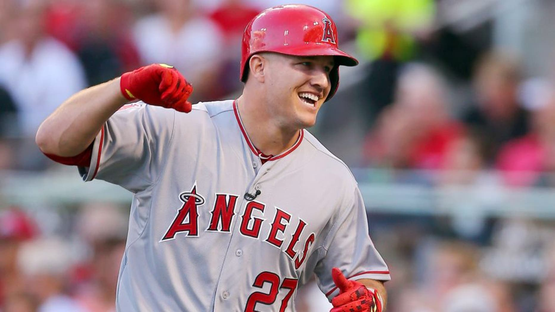 American League All-Star Mike Trout #27 of the Los Angeles Angels of Anaheim celebrates after hitting a lead off home run in the first inning against National League All-Star Zack Greinke #21 of the Los Angeles Dodgers during the 86th MLB All-Star Game at the Great American Ball Park on July 14, 2015 in Cincinnati, Ohio. (Photo by Elsa/Getty Images)
