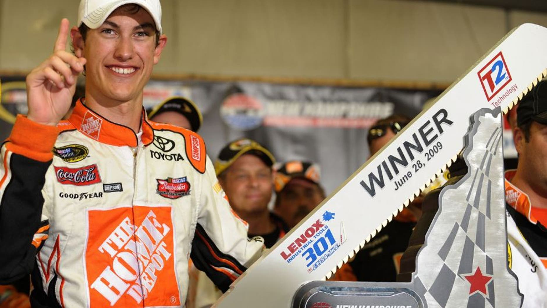 LOUDON, NH - JUNE 28: Joey Logano, driver of the #20 Home Depot Toyota, celebrates winning the NASCAR Sprint Cup Series LENOX Industrial Tools 301 at New Hampshire Motor Speedway on June 28, 2009 in Loudon, New Hampshire. Logano won the rain shortened race with 27 laps remaining. (Photo by Drew Hallowell/Getty Images for NASCAR)