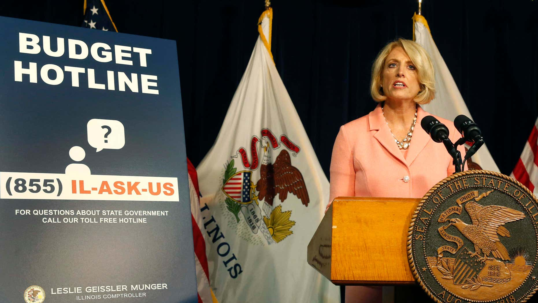 Illinois Comptroller Leslie Geissler Munger begins a news conference on the state budget Thursday, July 14, 2016, in Chicago.