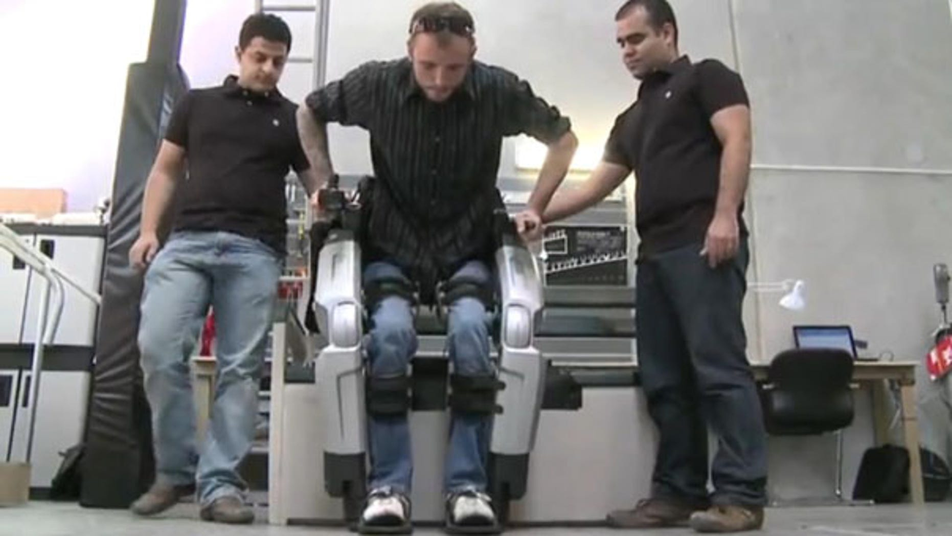 """Hayden Allen, who injured his spinal cord five years ago, tests out Rex, the robotic exoskeleton. """"I'll never forget what it was like to see my feet walking under me the first time I used Rex,"""" said Hayden."""