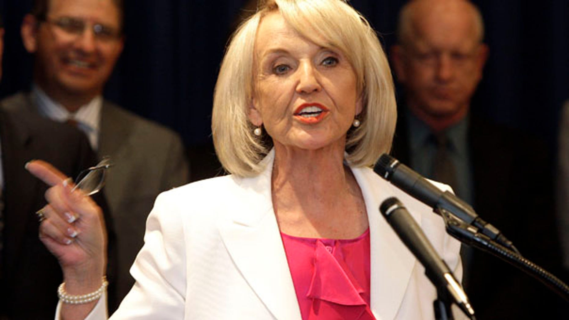 Arizona Gov. Jan Brewer, seen in this 2010 file photo, has vetoed a bill that would have allowed guns on public college campuses.