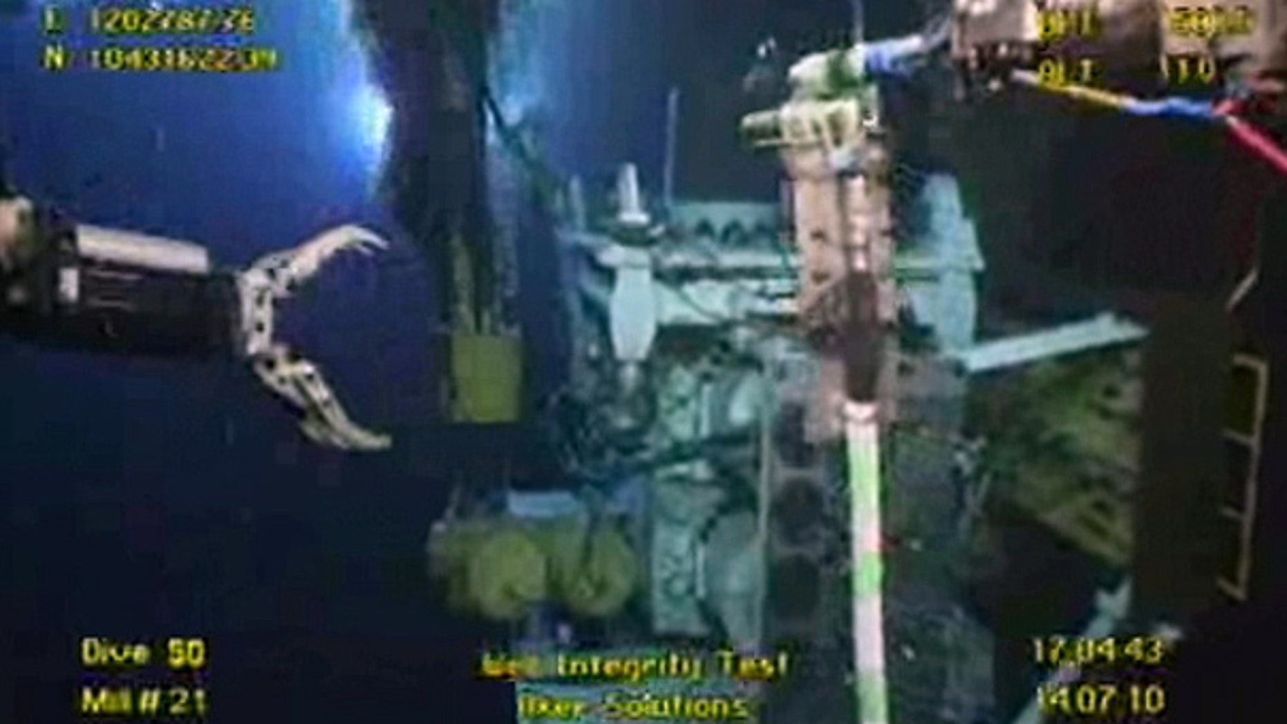 July 14: Underwater robots are seen working at the site of the BP leak in the Gulf.