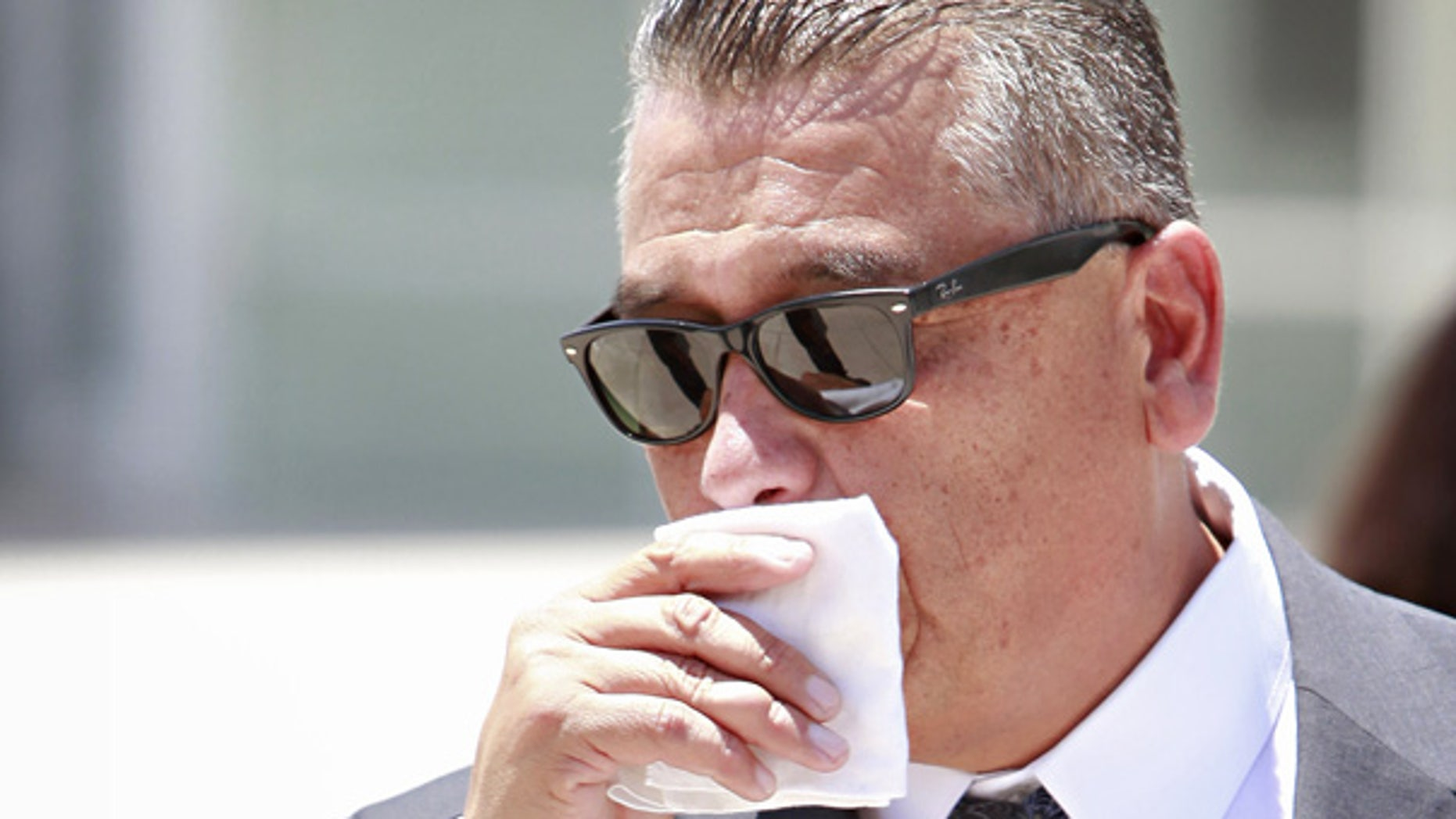 July 15: Phoenix police officer David Salgado leaves the federal courthouse in Phoenix.