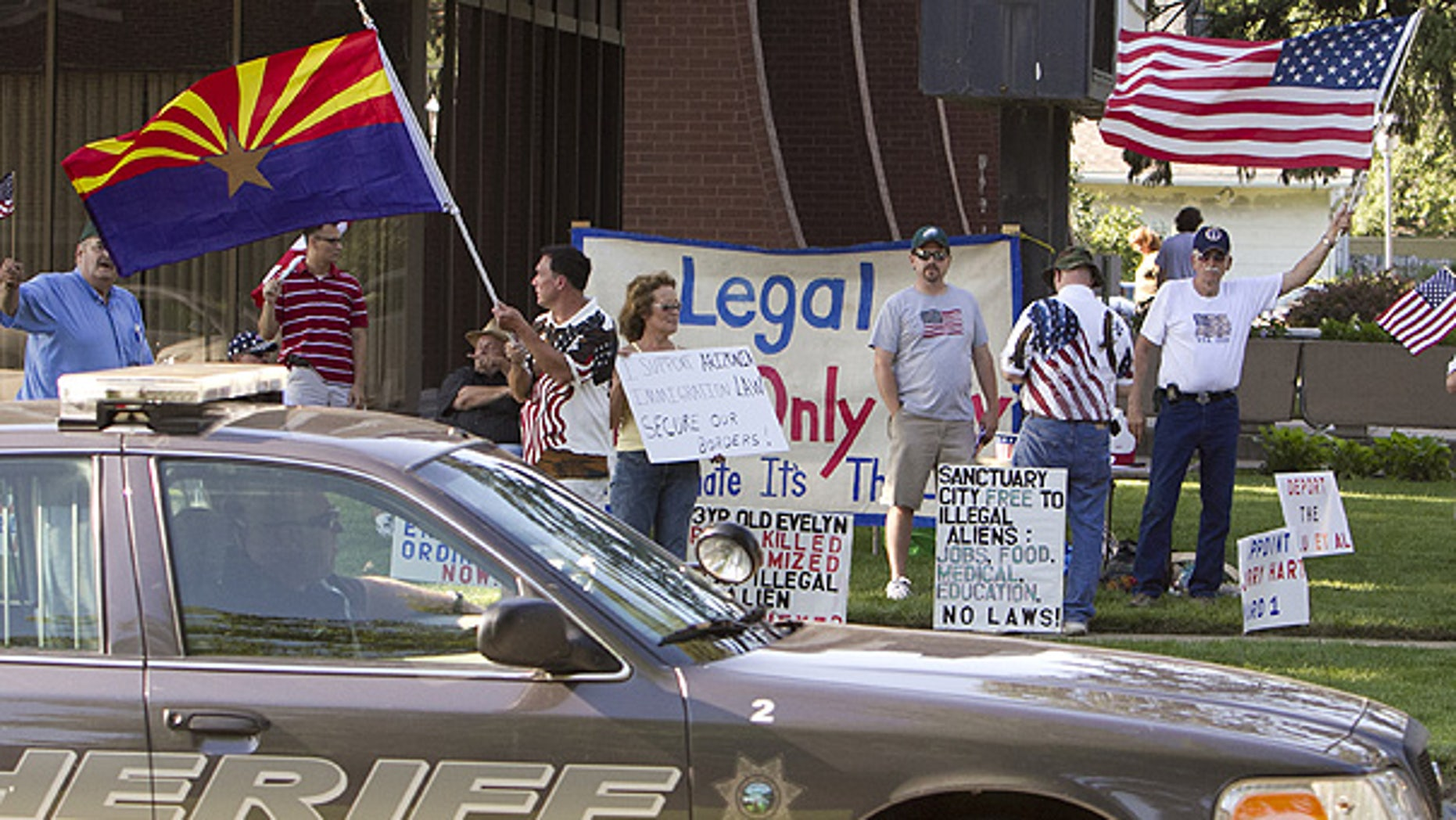 July 13: A group demonstrates against illegal immigration outside the Fremont, Nebraska, city hall.
