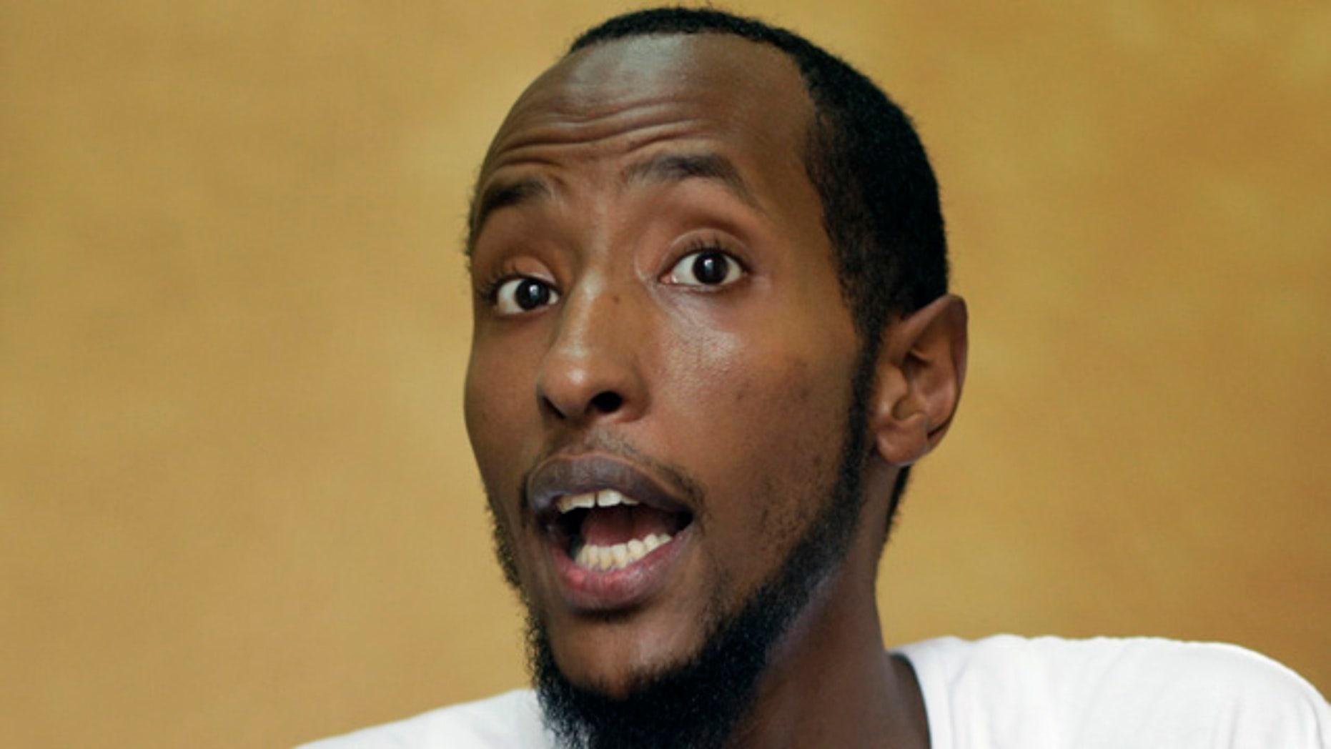 June 16: Yahya Wehelie, from Burke, Va., displays his U.S. passport, in Cairo, Egypt.