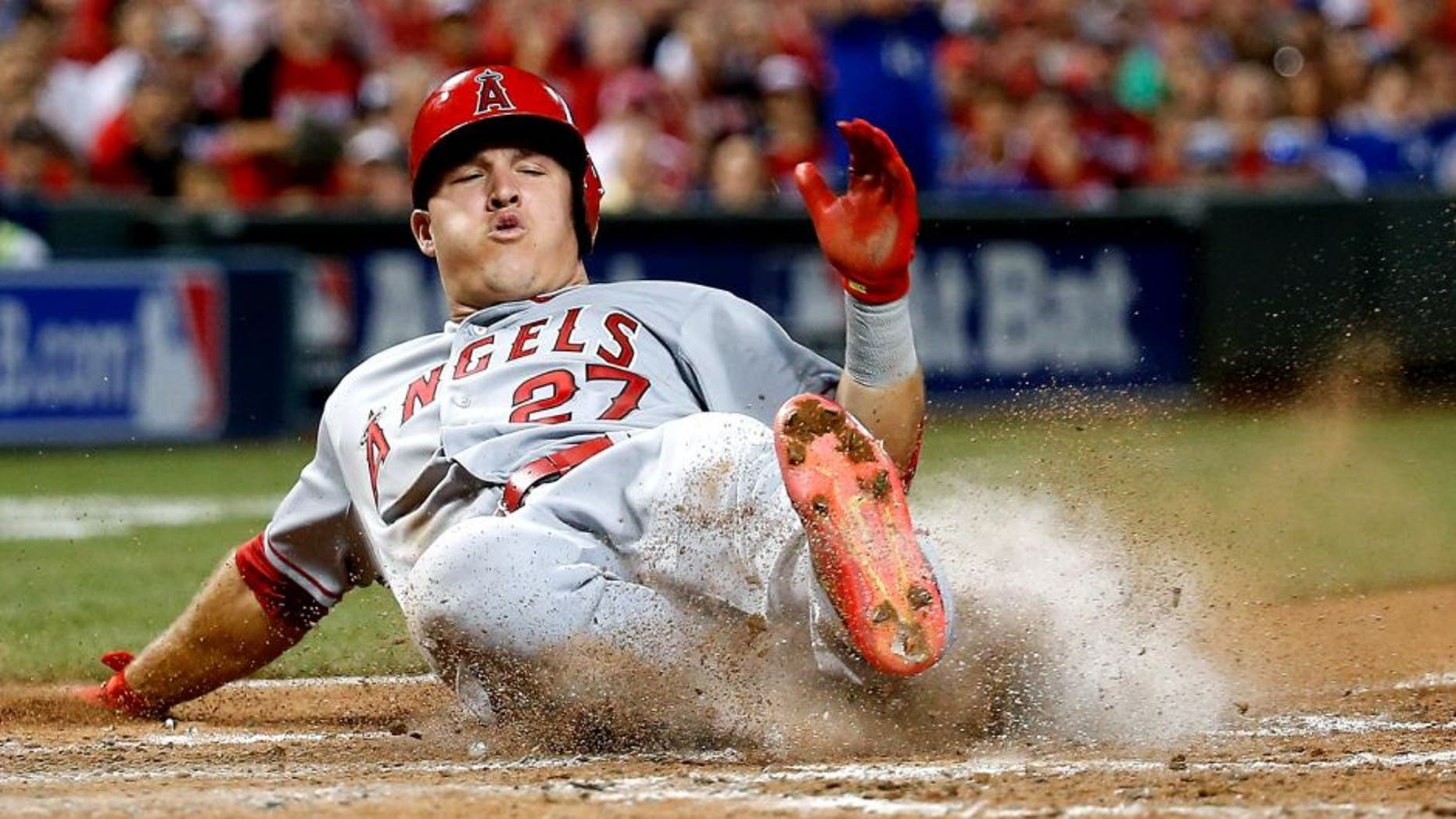 CINCINNATI, OH - JULY 14: American League All-Star Mike Trout #27 of the Los Angeles Angels of Anaheim slides home to score off of American League All-Star Prince Fielder #84 of the Texas Rangers single to left field against National League All-Star Clayton Kershaw #22 of the Los Angeles Dodgers during the 86th MLB All-Star Game at the Great American Ball Park on July 14, 2015 in Cincinnati, Ohio. (Photo by Rob Carr/Getty Images)