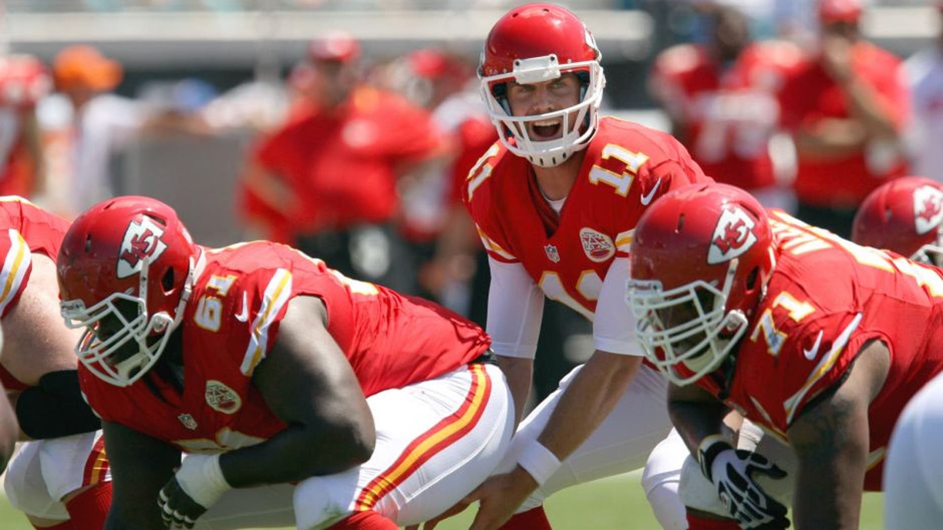 Sep 8, 2013; Jacksonville, FL, USA; Kansas City Chiefs quarterback Alex Smith (11) yells to the offensive line during the game against the Jacksonville Jaguars at EverBank Field. Mandatory Credit: Rob Foldy-USA TODAY Sports