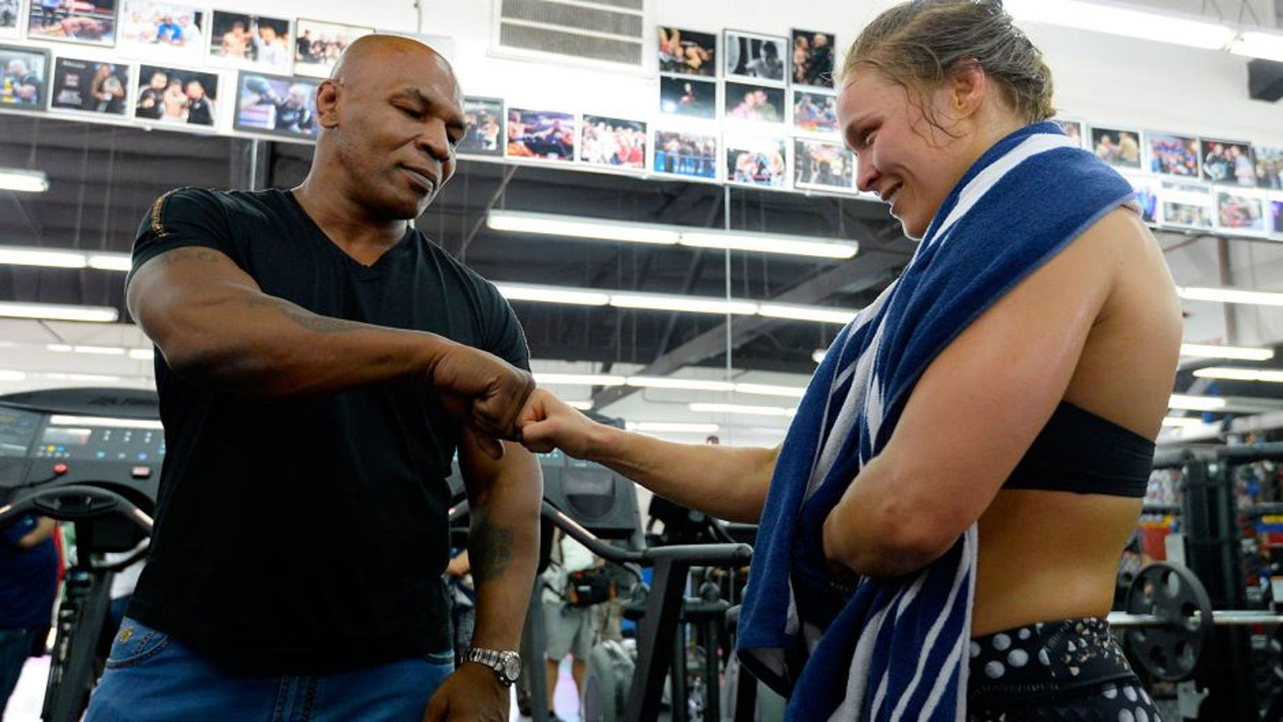 GLENDALE, CA - JULY 15: Former boxer Mike Tyson meets UFC Bantamweight champion Ronda Rousey during a media training session at the Glendale Fight Club on July 15, 2015 in Glendale, California. (Photo by Robert Laberge/Zuffa LLC/Zuffa LLC via Getty Images)