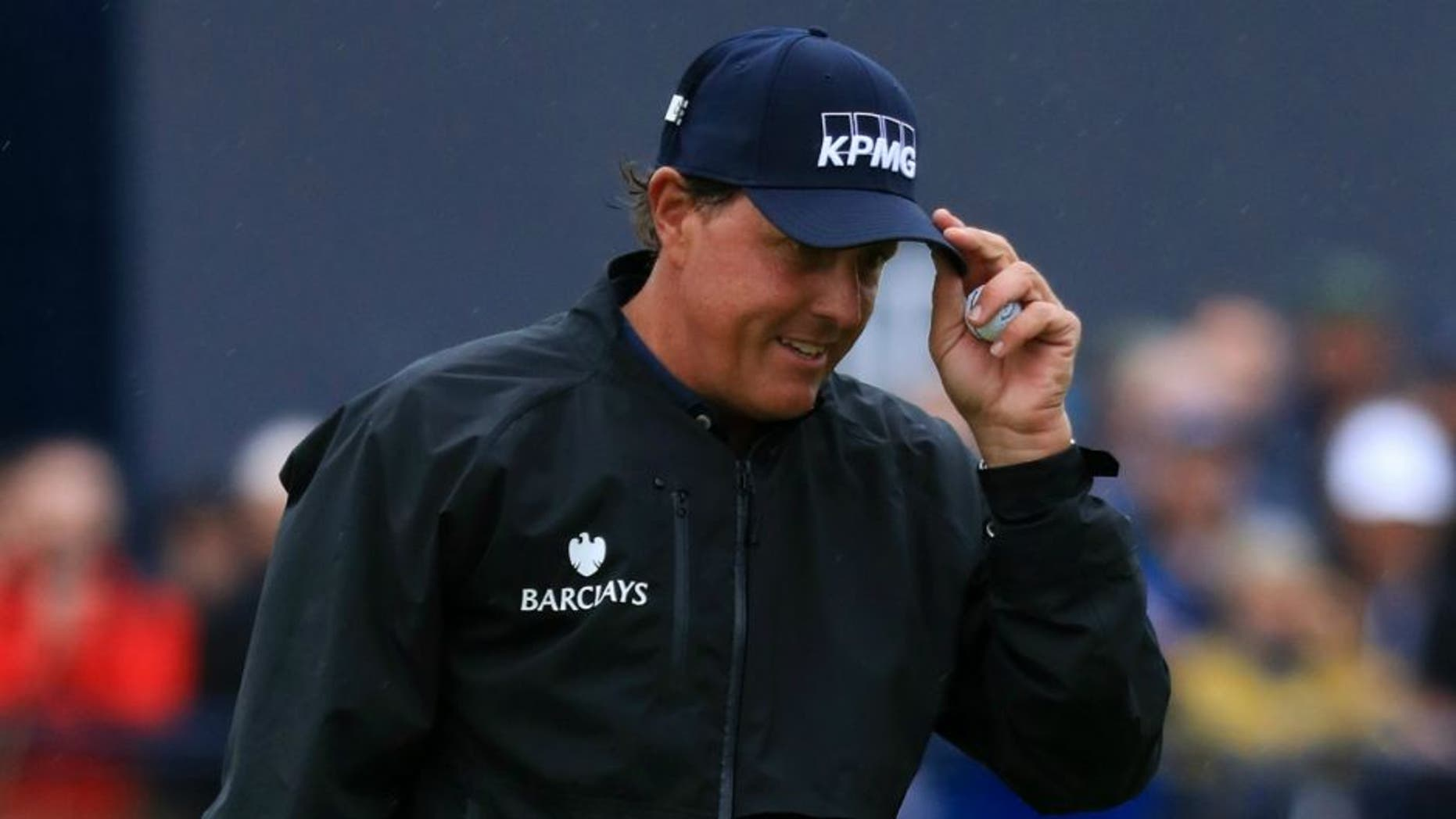 TROON, SCOTLAND - JULY 15: Phil Mickelson of the United States acknowledges the crowd after putting on the 18th green during the second round on day two of the 145th Open Championship at Royal Troon on July 15, 2016 in Troon, Scotland. (Photo by Matthew Lewis/Getty Images)