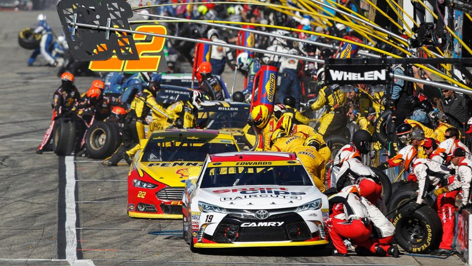 Carl Edwards, driver of the #19 Sport Clips Toyota, pits during the NASCAR Sprint Cup Series SYLVANIA 300 at New Hampshire Motor Speedway on September 27, 2015 in Loudon, New Hampshire.