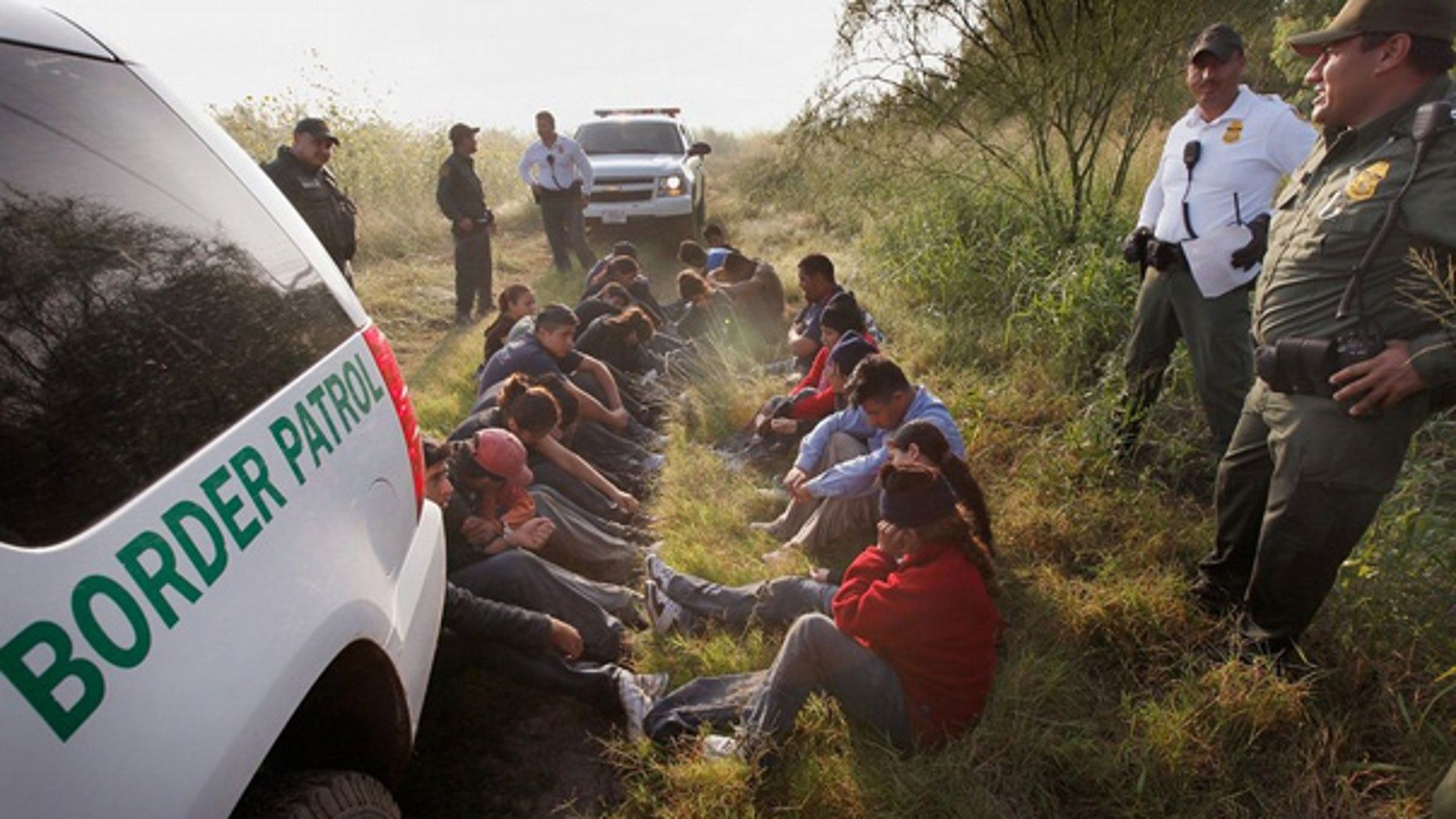 May 28: Border Patrol agents detain undocumented immigrants apprehended near McAllen, Texas.