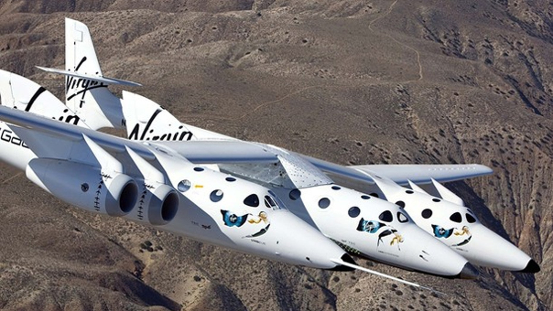 March 22: Virgin Galactic's SpaceShipTwo, which can hold six passengers, is seen on its maiden flight over the Mojave Desert.