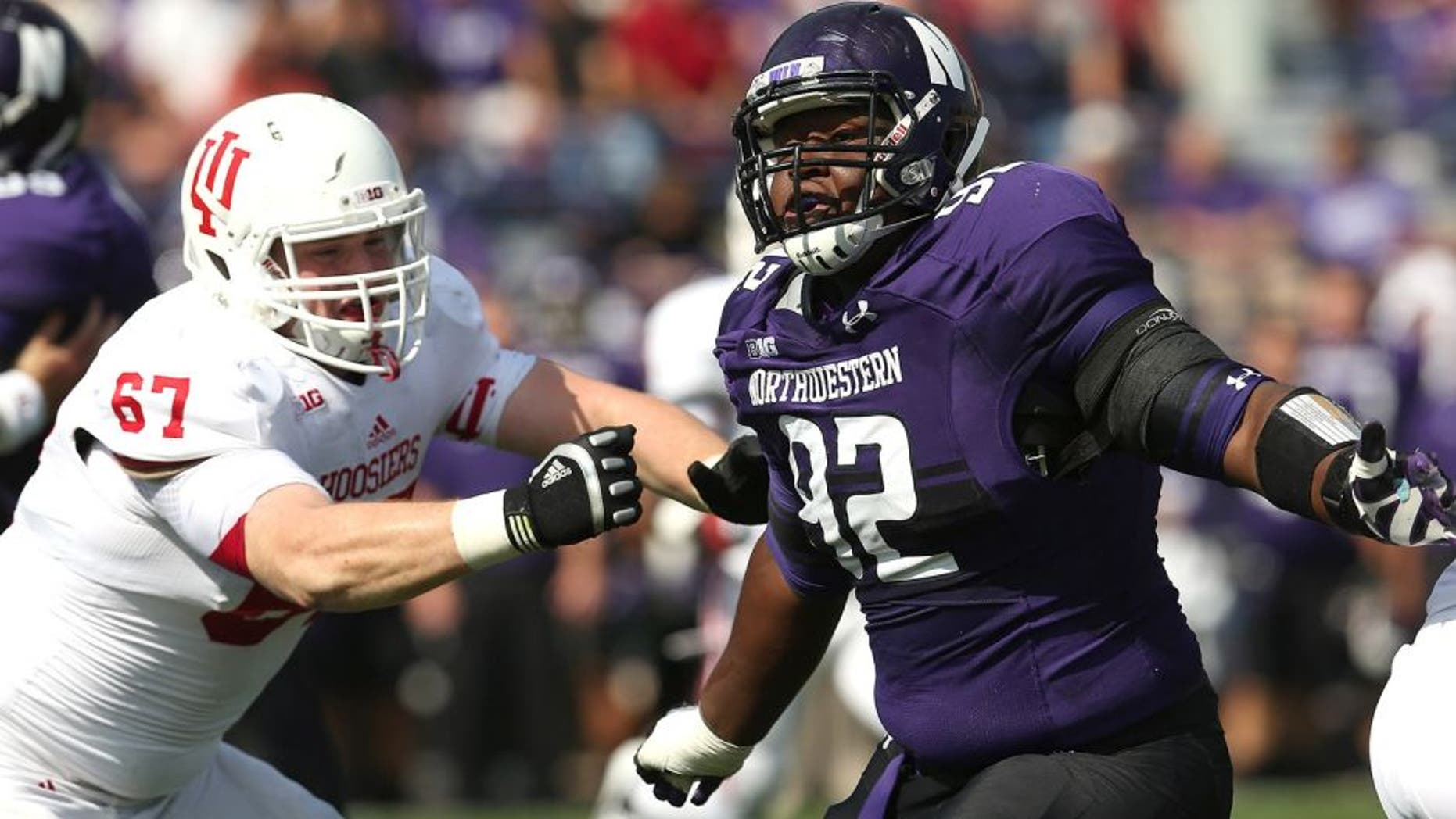 EVANSTON, IL - SEPTEMBER 29: Will Hampton #92 of the Northwestern Wildcats rushes against Dan Feeney #67 of the Indiana Hoosiers at Ryan Field on September 29, 2012 in Evanston, Illinois. Northwestern defeated Indiana 44-29. (Photo by Jonathan Daniel/Getty Images) *** Local Caption *** Will Hampton; Dan Feeney