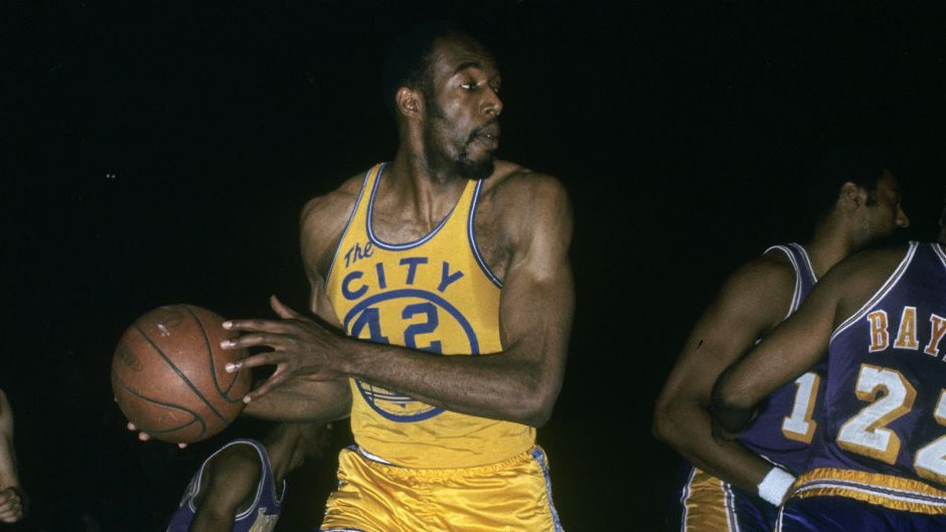 SAN FRANCISCO, CA - CIRCA 1960's: Nate Thurmond #42 of the San Francisco Warriors in action pulling down a rebound against the Los Angeles Lakers during an late circa 1960's NBA basketball game at the Cow Palace in San Francisco, California. Thurmond played for the Warriors 1963-74. (Photo by Focus on Sport/Getty Images)